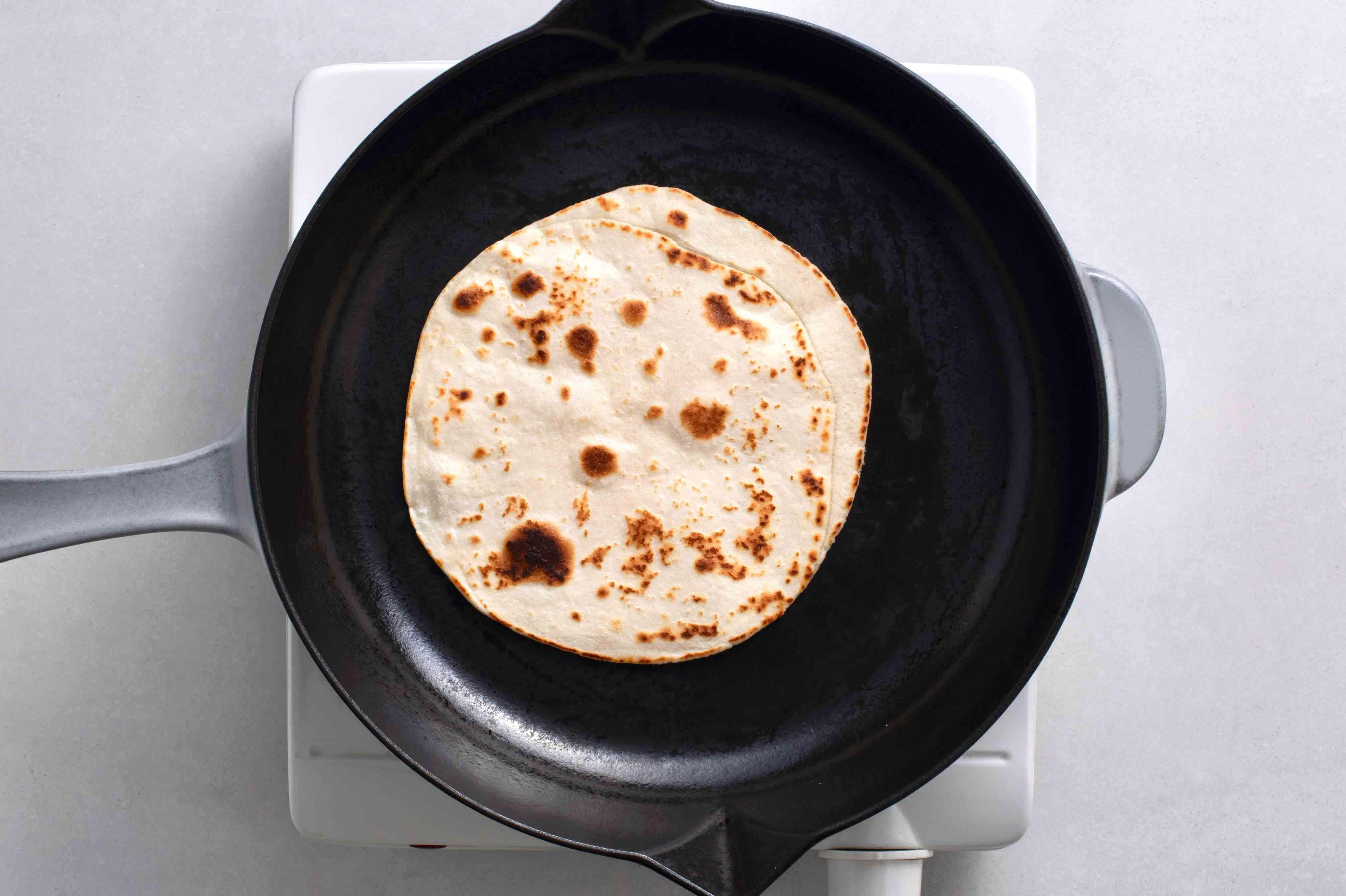 dough frying in a pan
