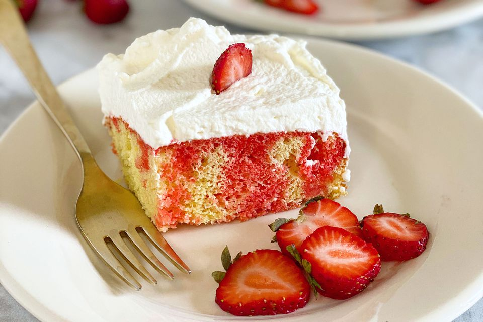 slice of strawberry poke cake