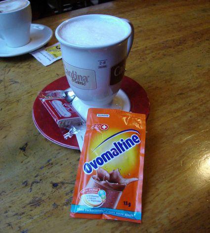 Ovomaltine near a cup.
