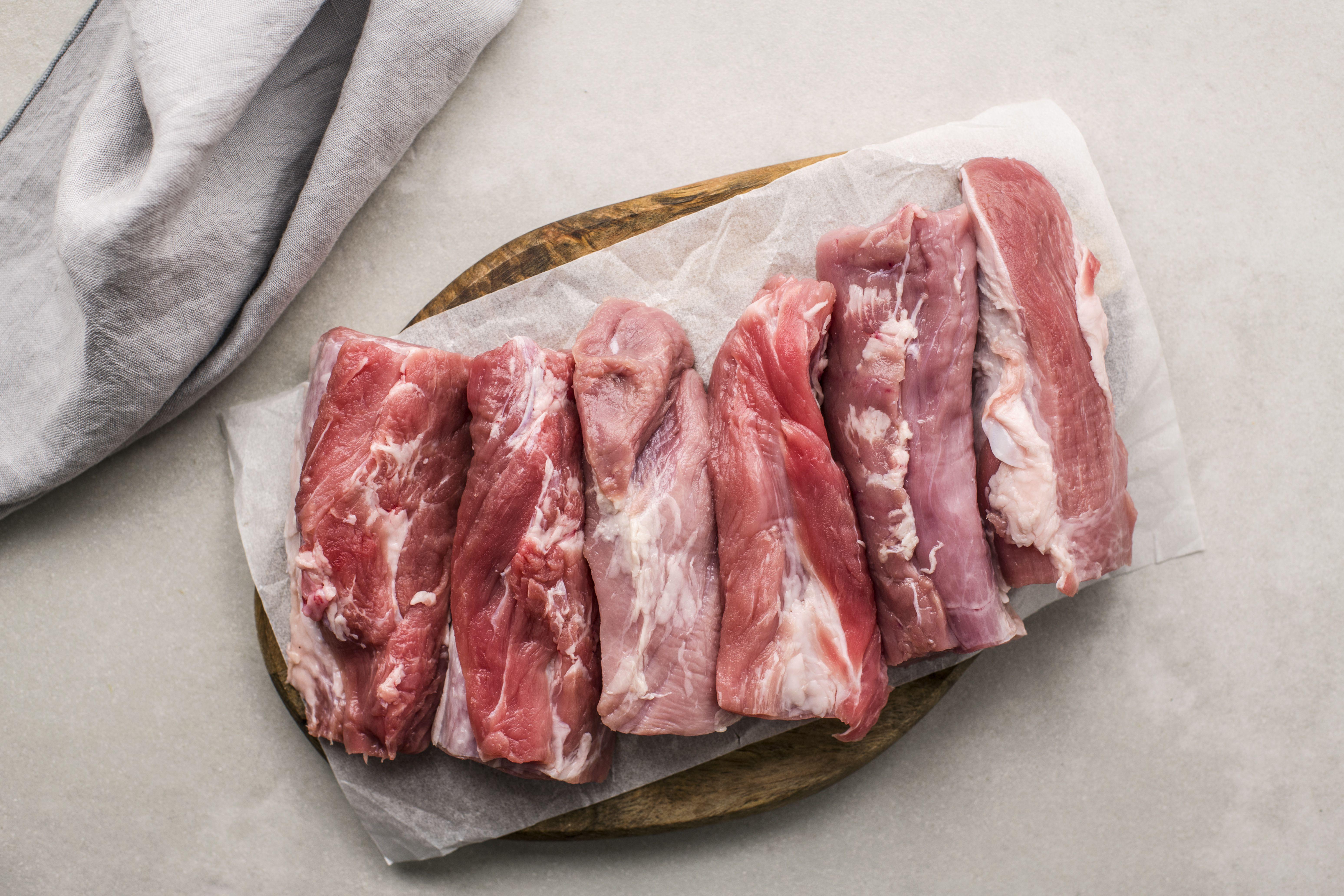 Cut the pork into strips