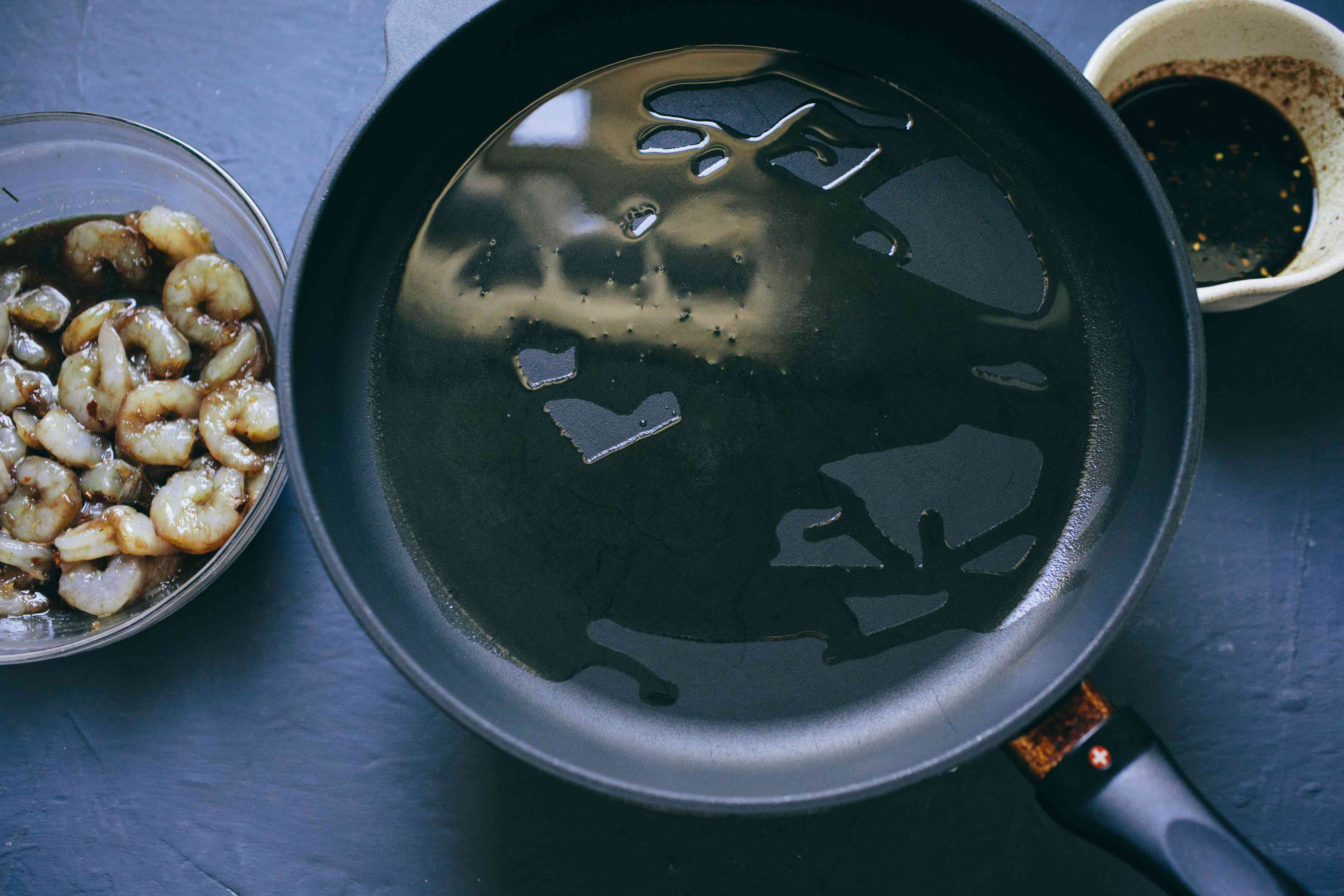 Heat oil in skillet for shrimp