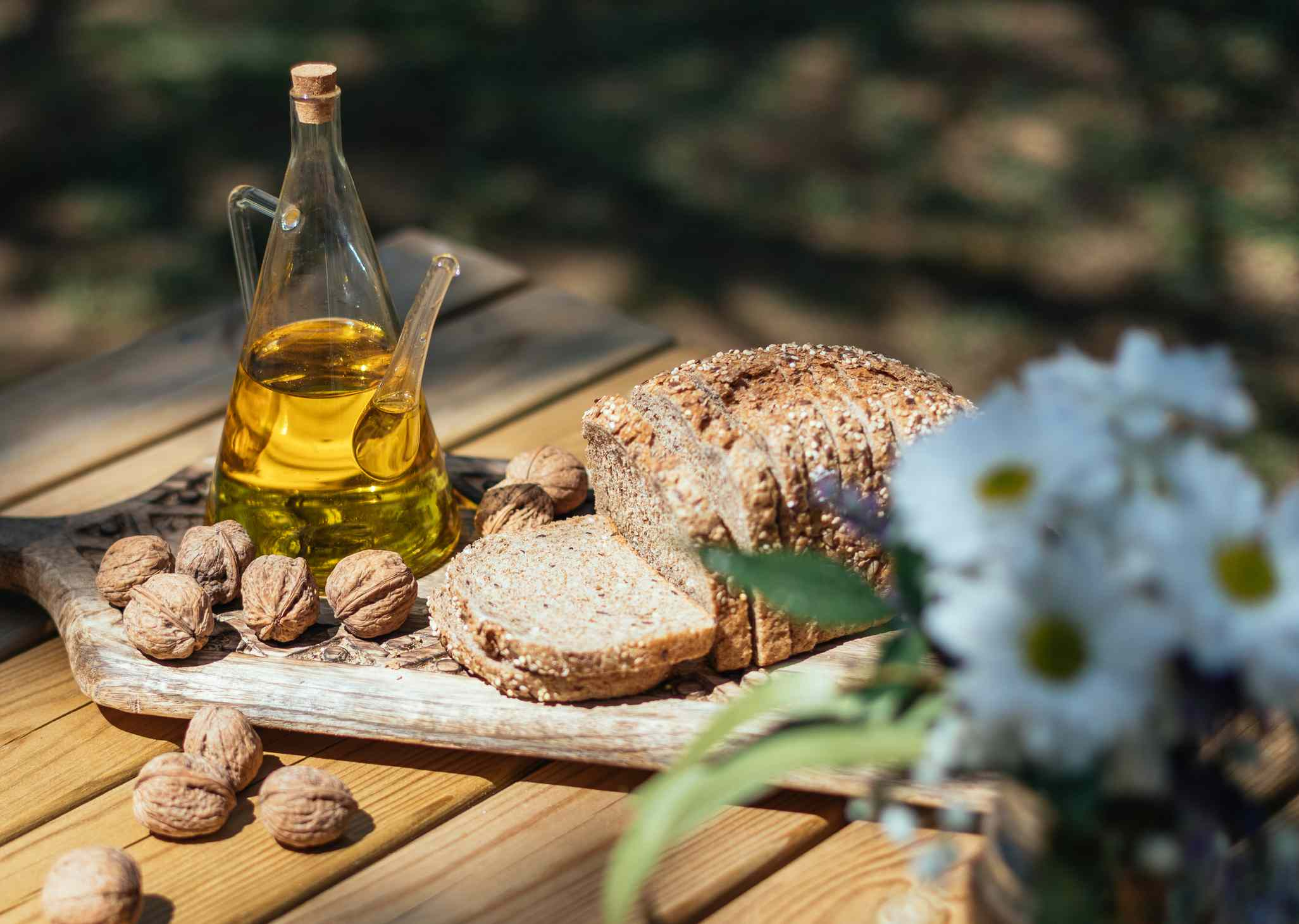 Walnut oil and a loaf of whole grain bread