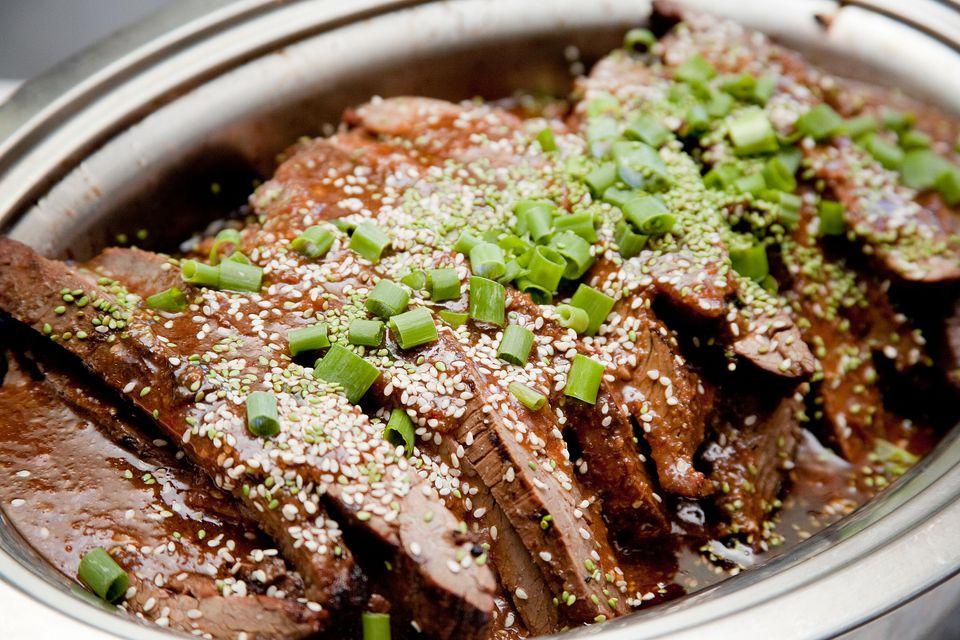 Asian Teriyaki Beef Dish with Sauce and Green Onions
