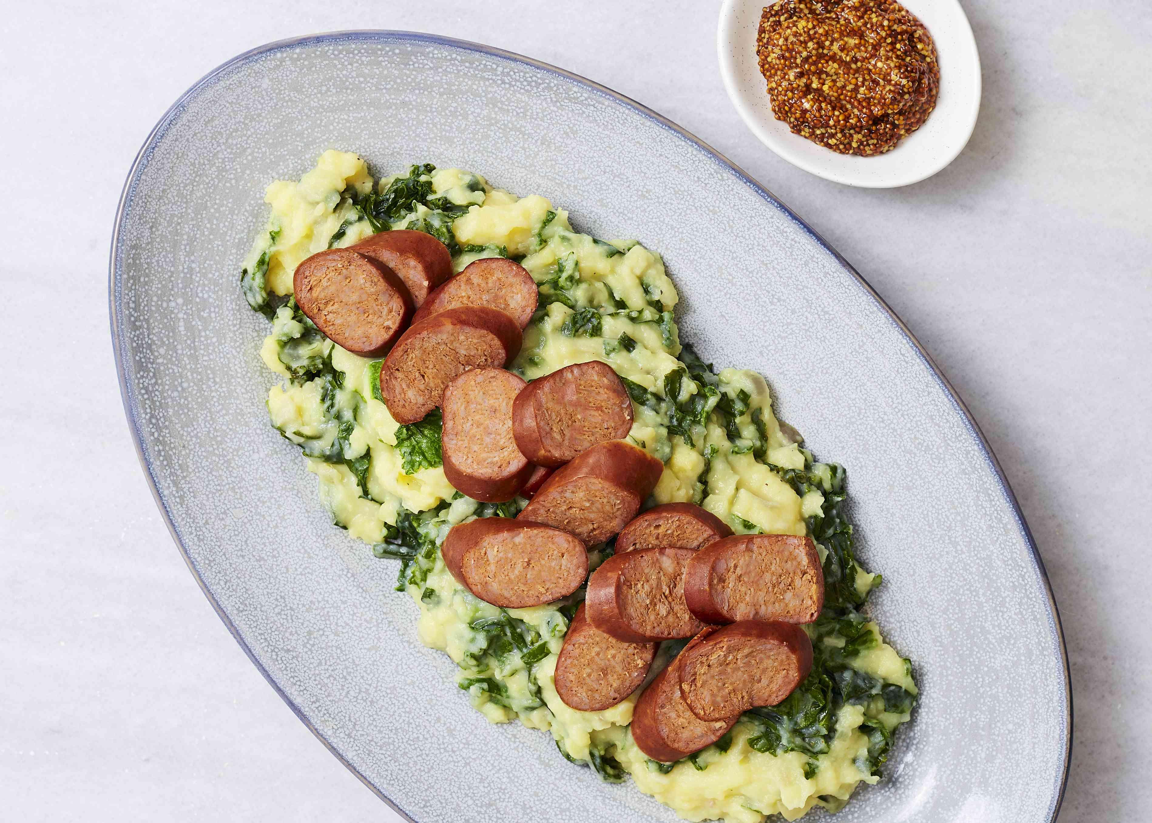 sliced sausage on top of potato mash