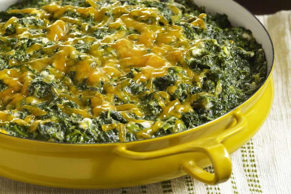 Creamed spinach with white sauce and cheese topping.