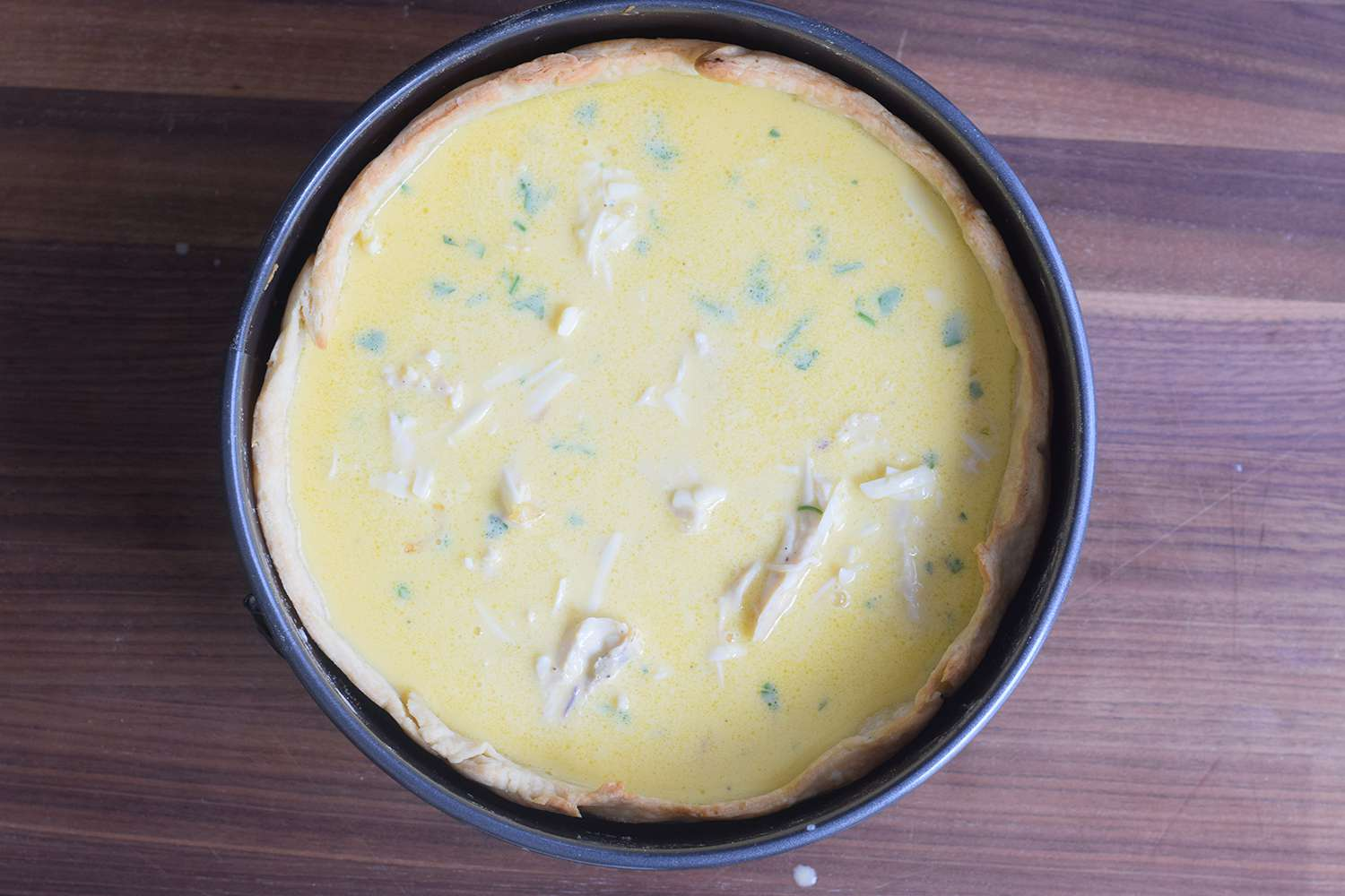 Pour the custard into the cooled pie crust