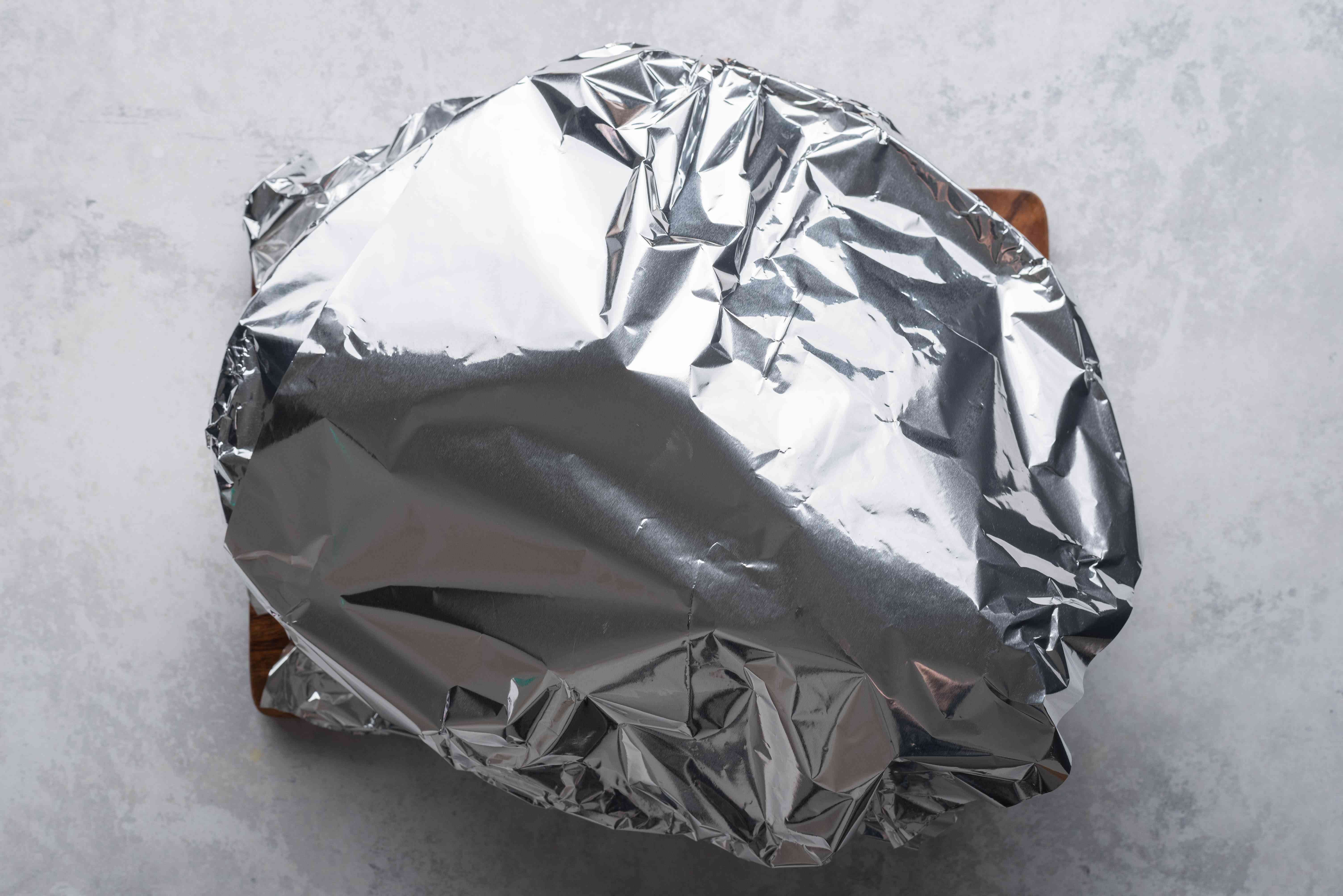chicken covered with aluminum foil