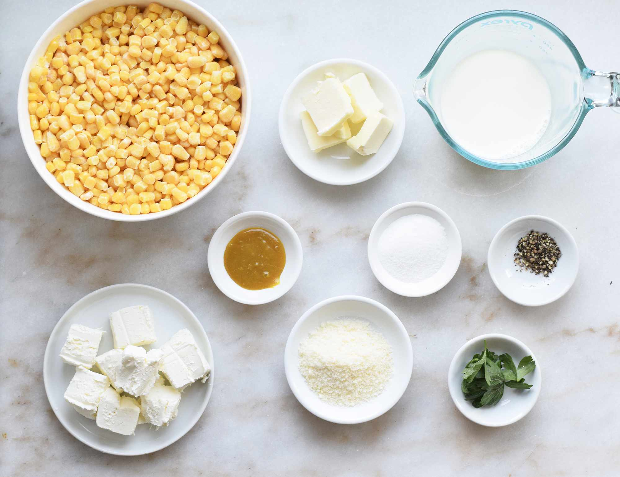 creamed corn ingredients on a marble board