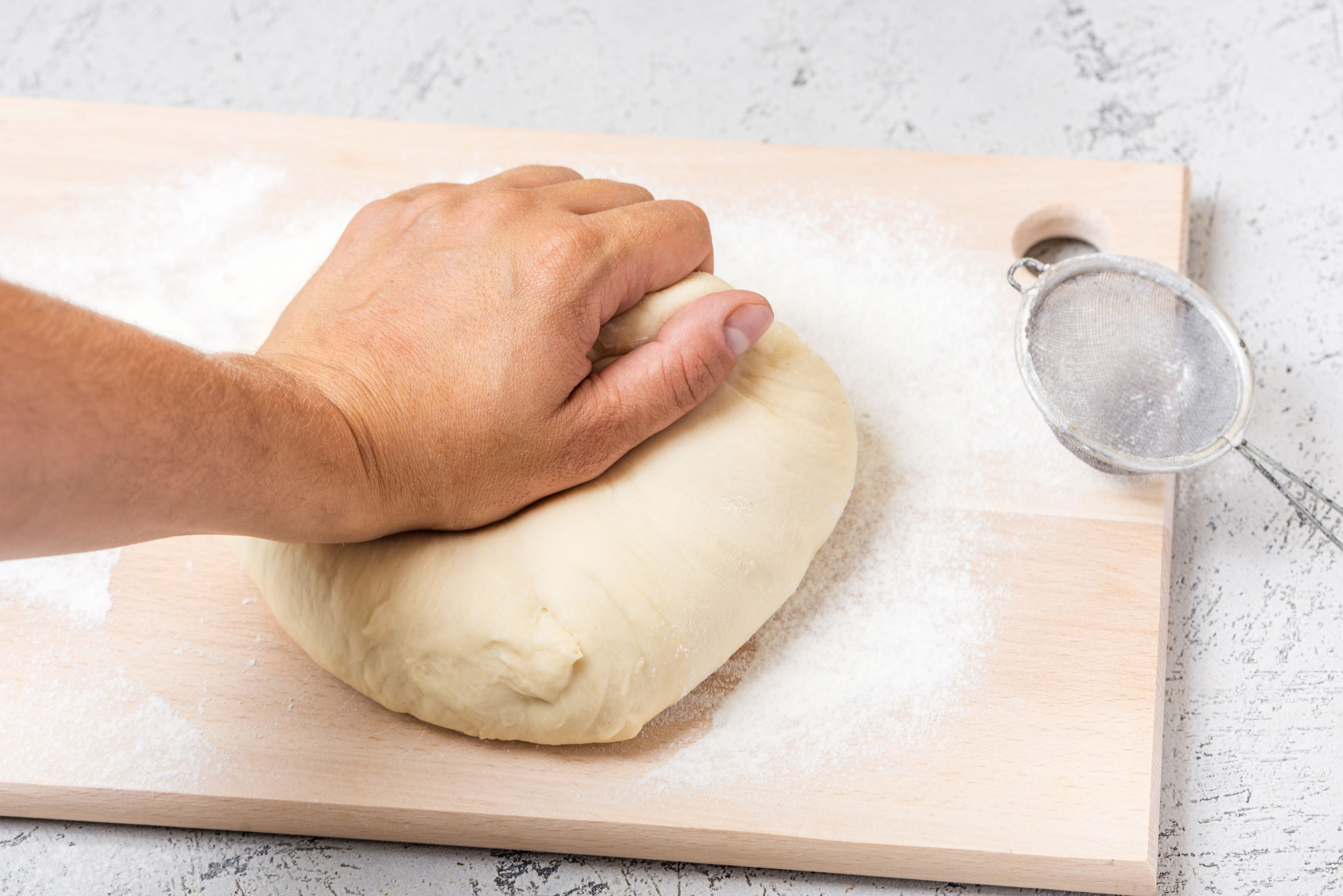 Kneading honey buttermilk bread dough