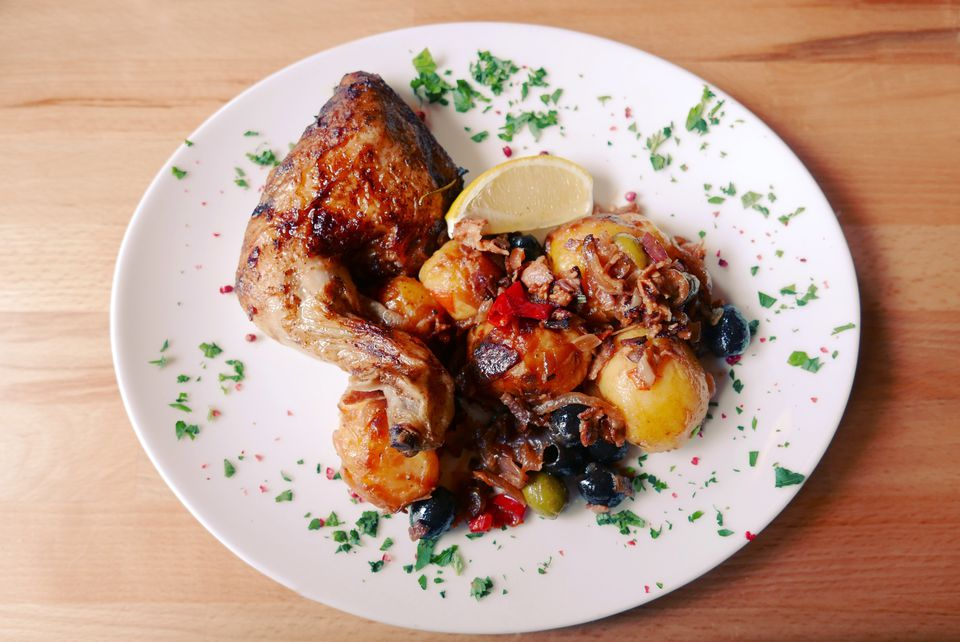 Lemon chicken with roasted potatoes on a plate