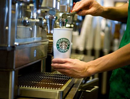 Barista pouring Starbucks coffee
