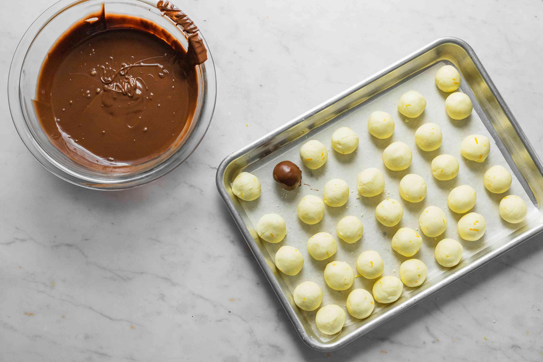 lemon cream balls on a baking sheet, chocolate covered lemon cream ball