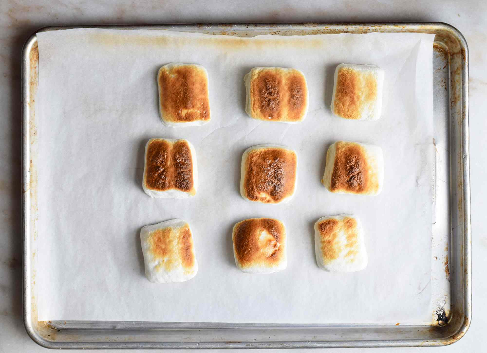 toasted marshmallows on a baking sheet