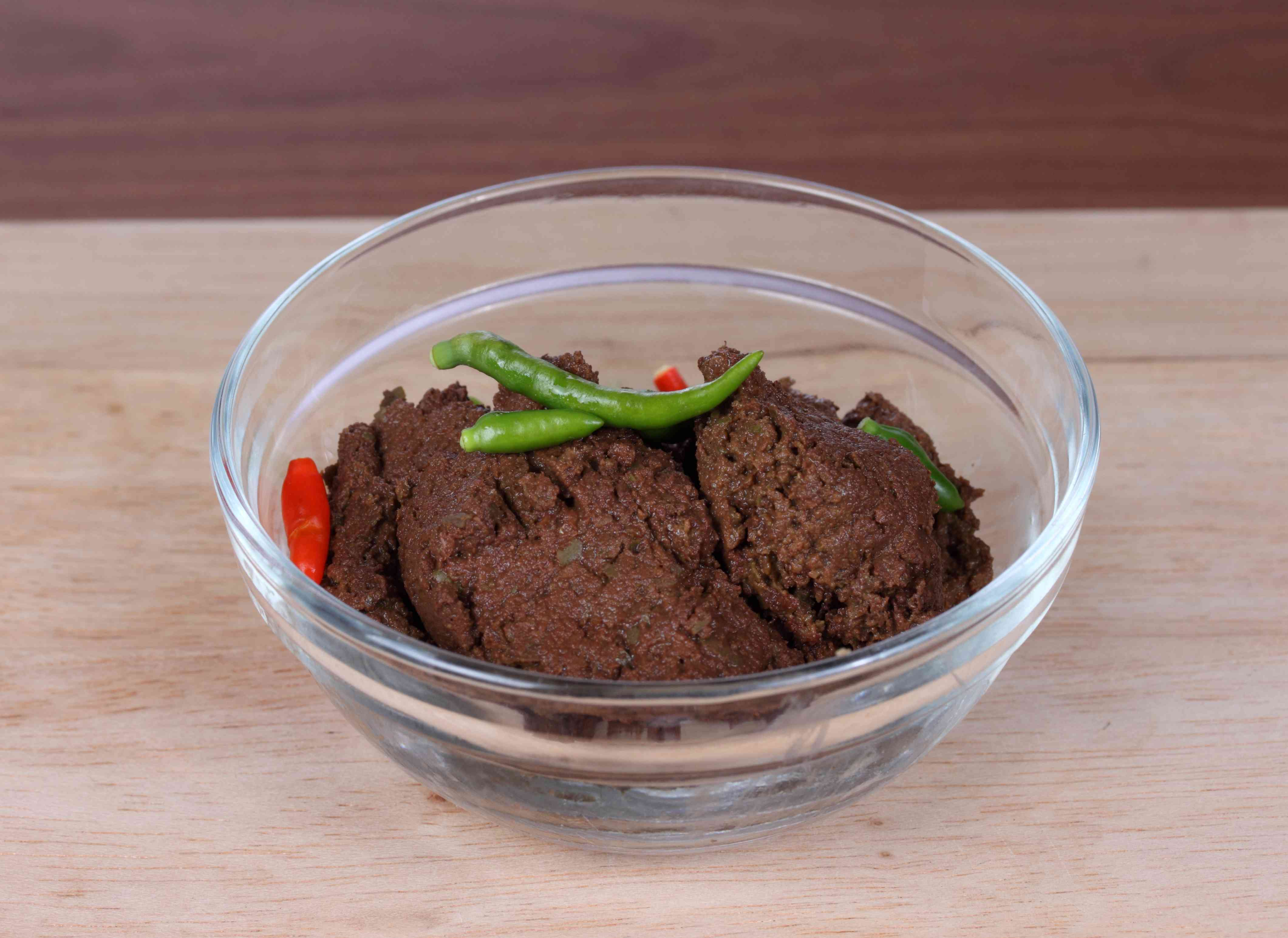 Tamarind paste in a glass bowl