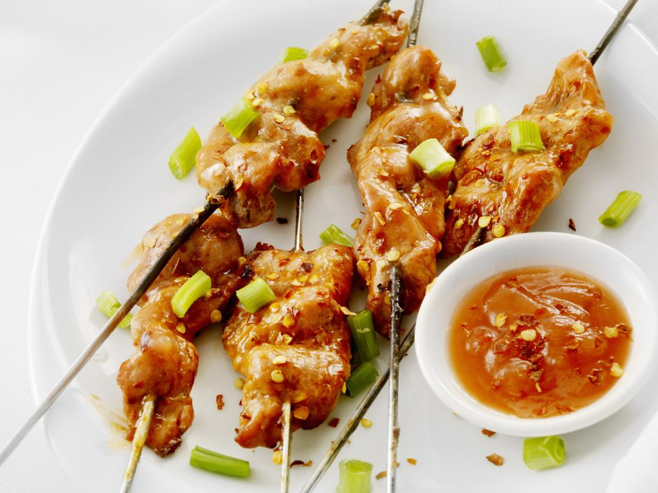 Pork skewers with sweet and sour sauce