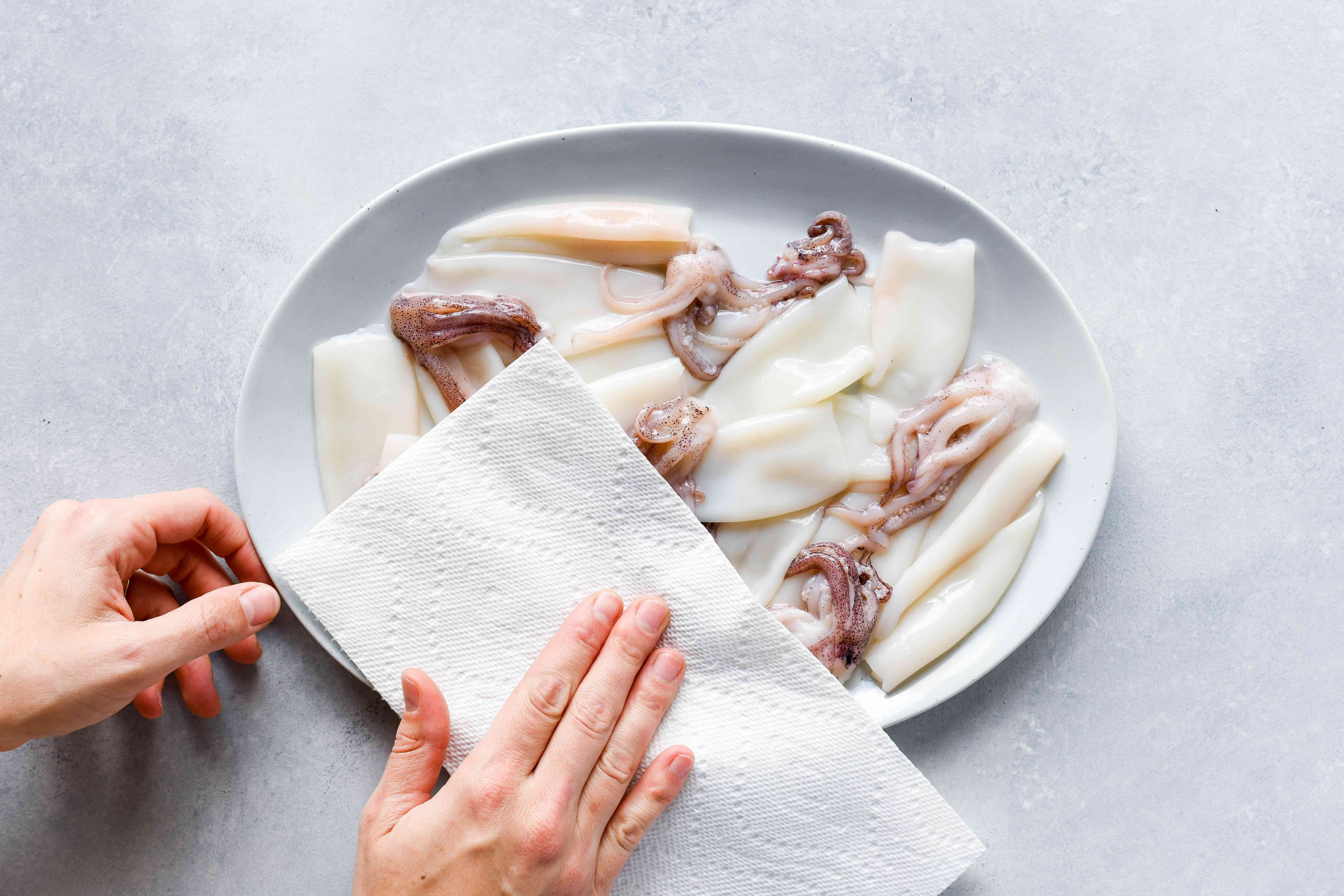pat dry Squid (Calamari) with a paper towl