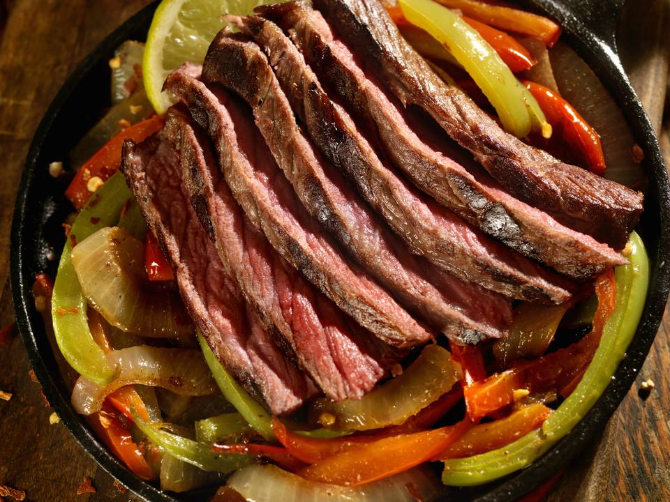 steak with peppers