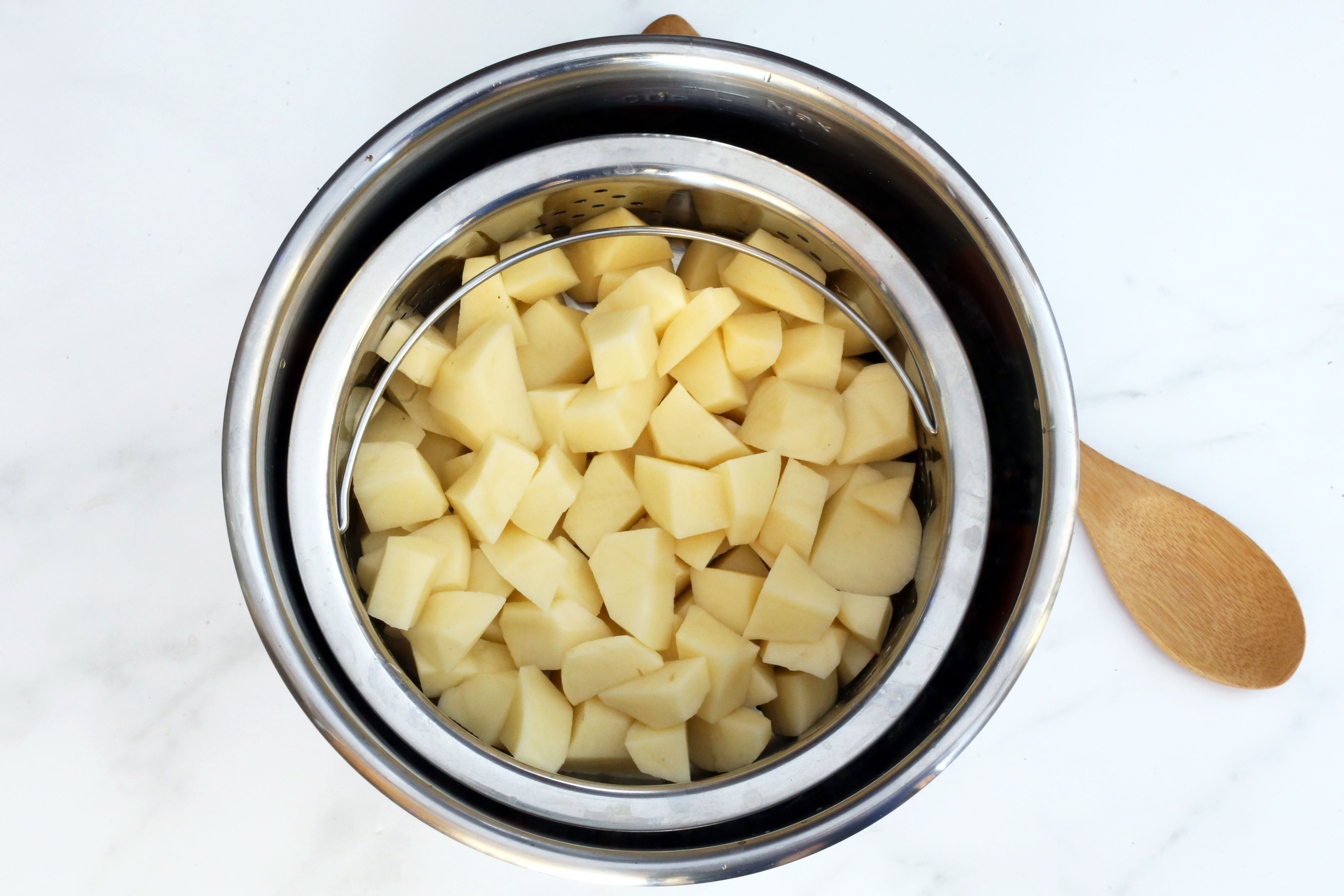 Add the steam basket and potatoes to the pot
