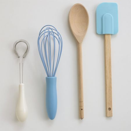 Whisks, wooden spoon and a spatula