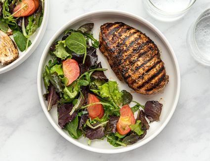 Balsamic Marinated Chicken Breasts on a plate with salad