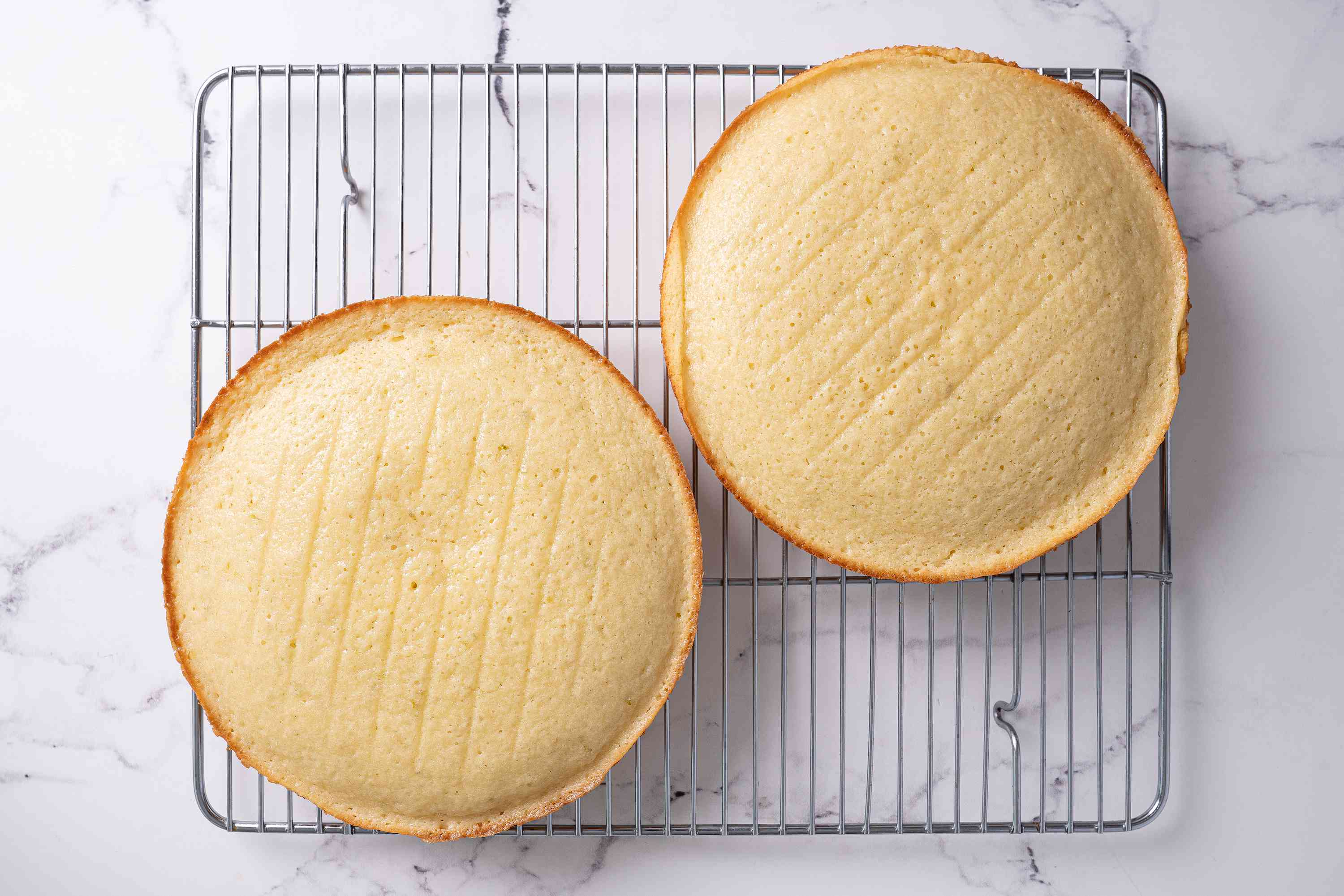 Two baked Key lime cakes cooling