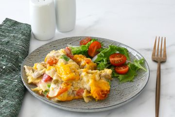 King Ranch chicken casserole with salad on a plate.