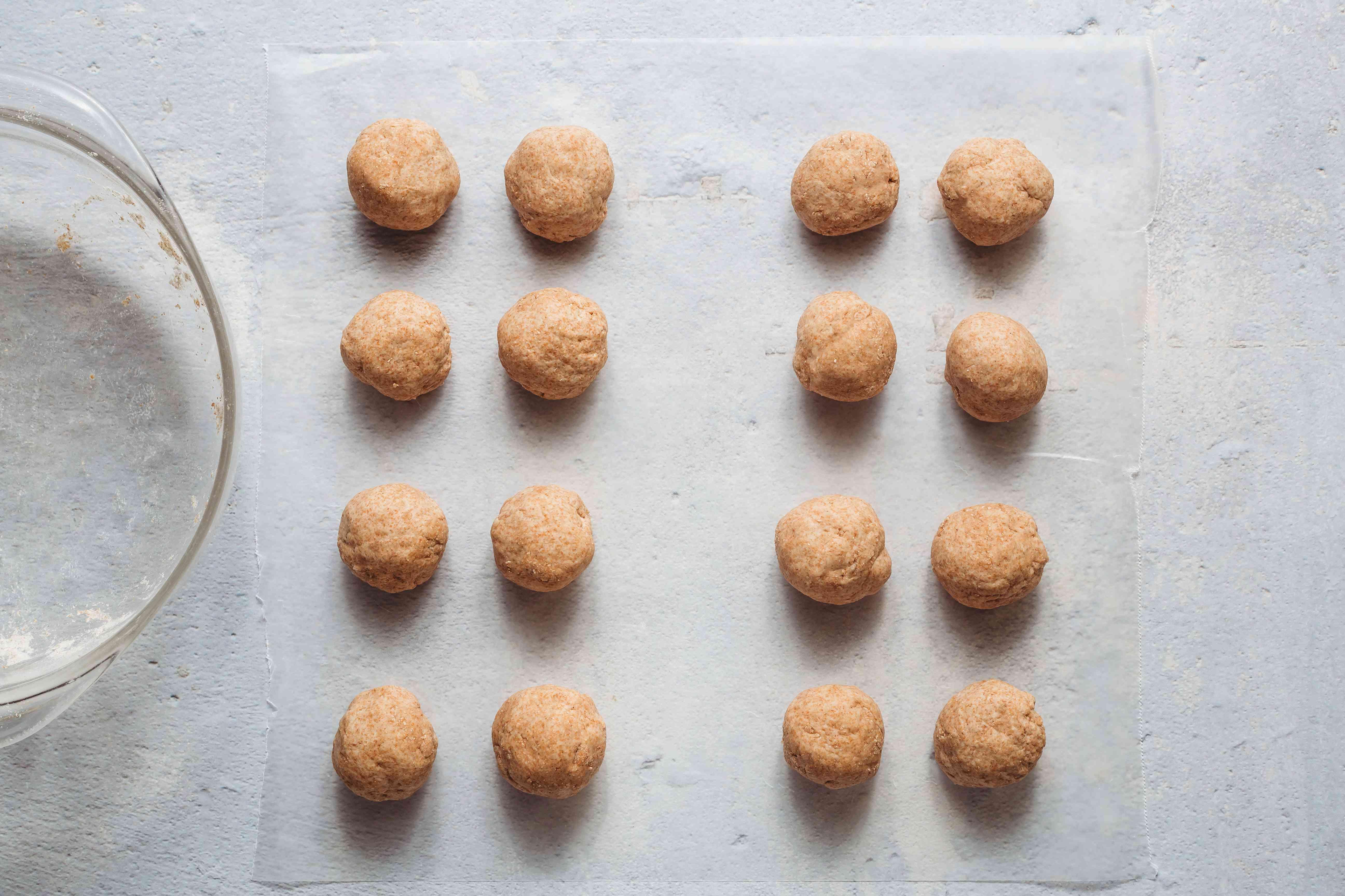 dough balls on parchment paper