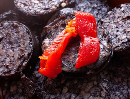 Close-up of red pepper on morcilla
