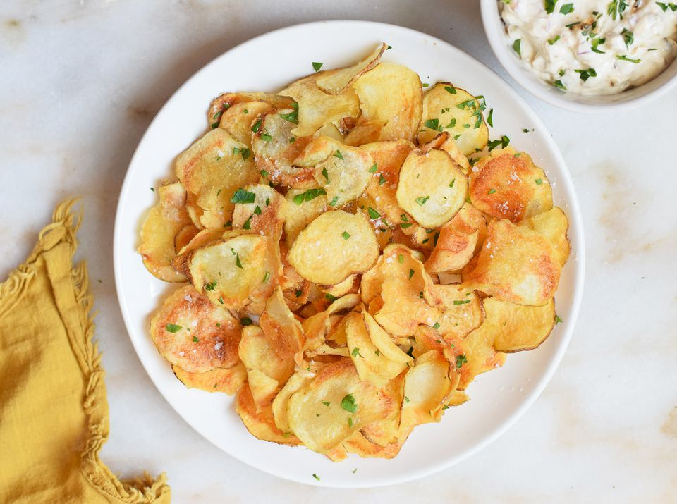air fryer potato chips garnished with parsley on a plate