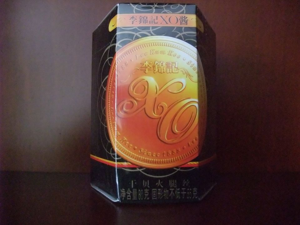 A jar of Lee Kum Kee XO sauce is packaged in a fancy black-and-gold box