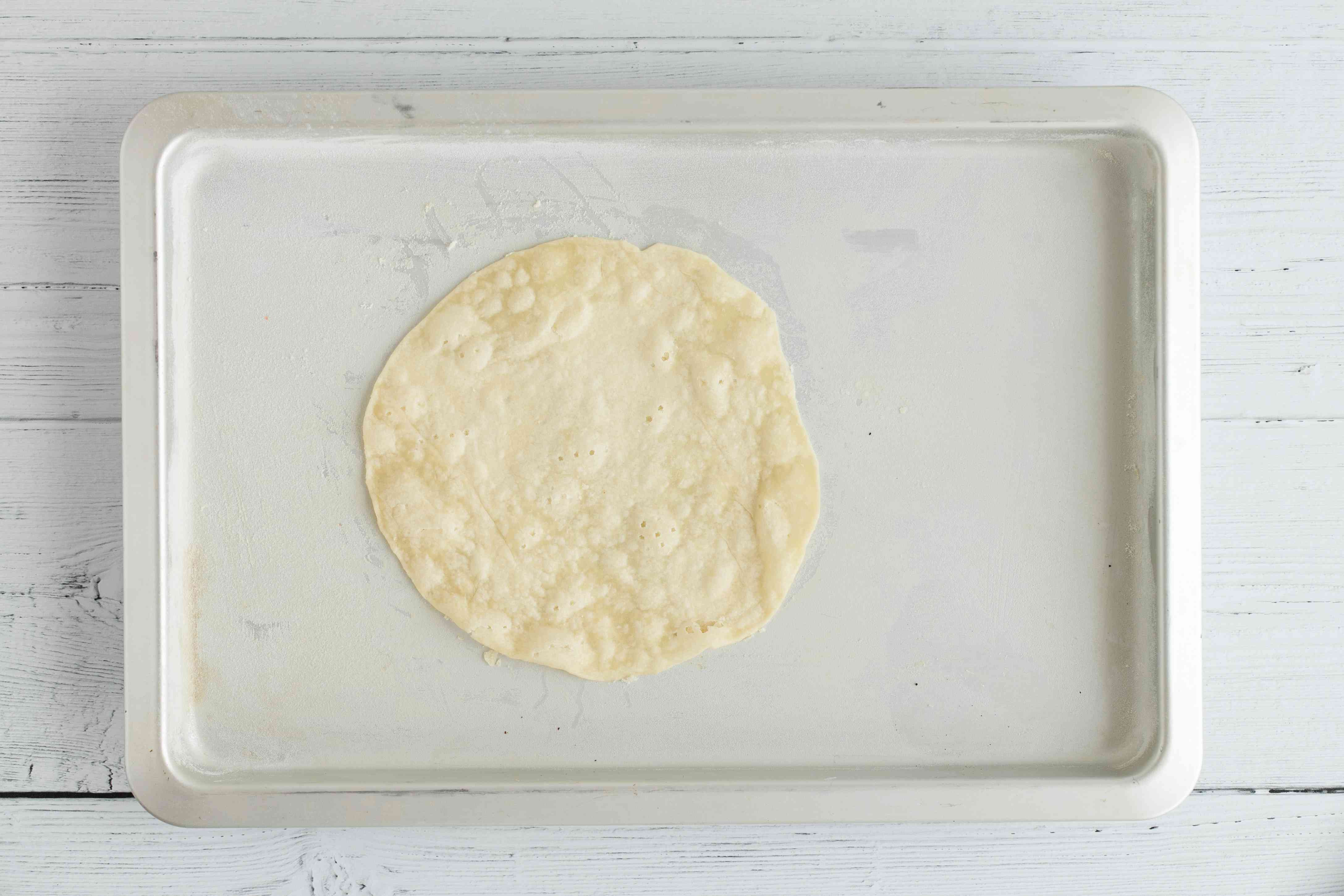 Baked pastry round on a baking sheet