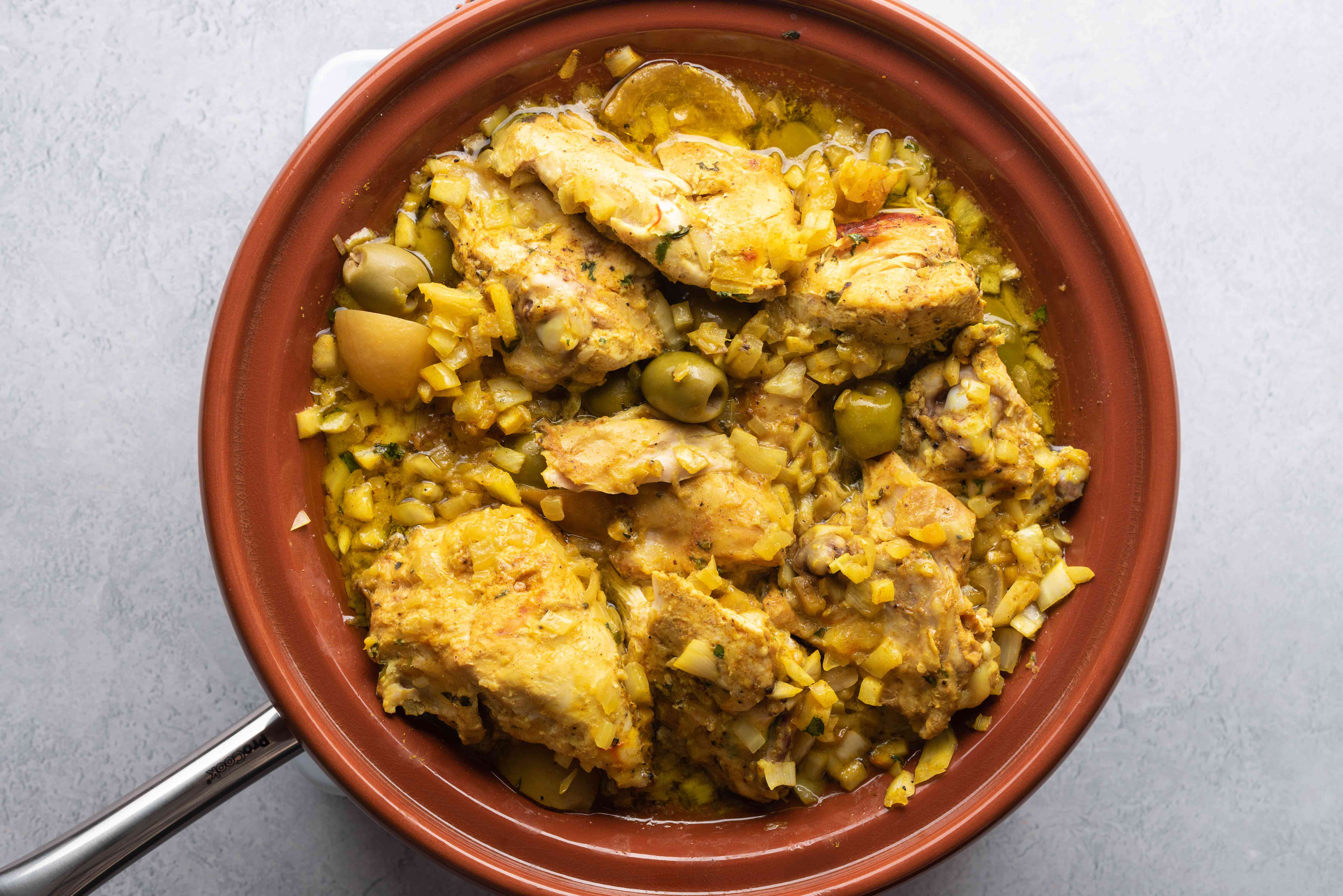 Allow the chicken to cook in the tagine undisturbed