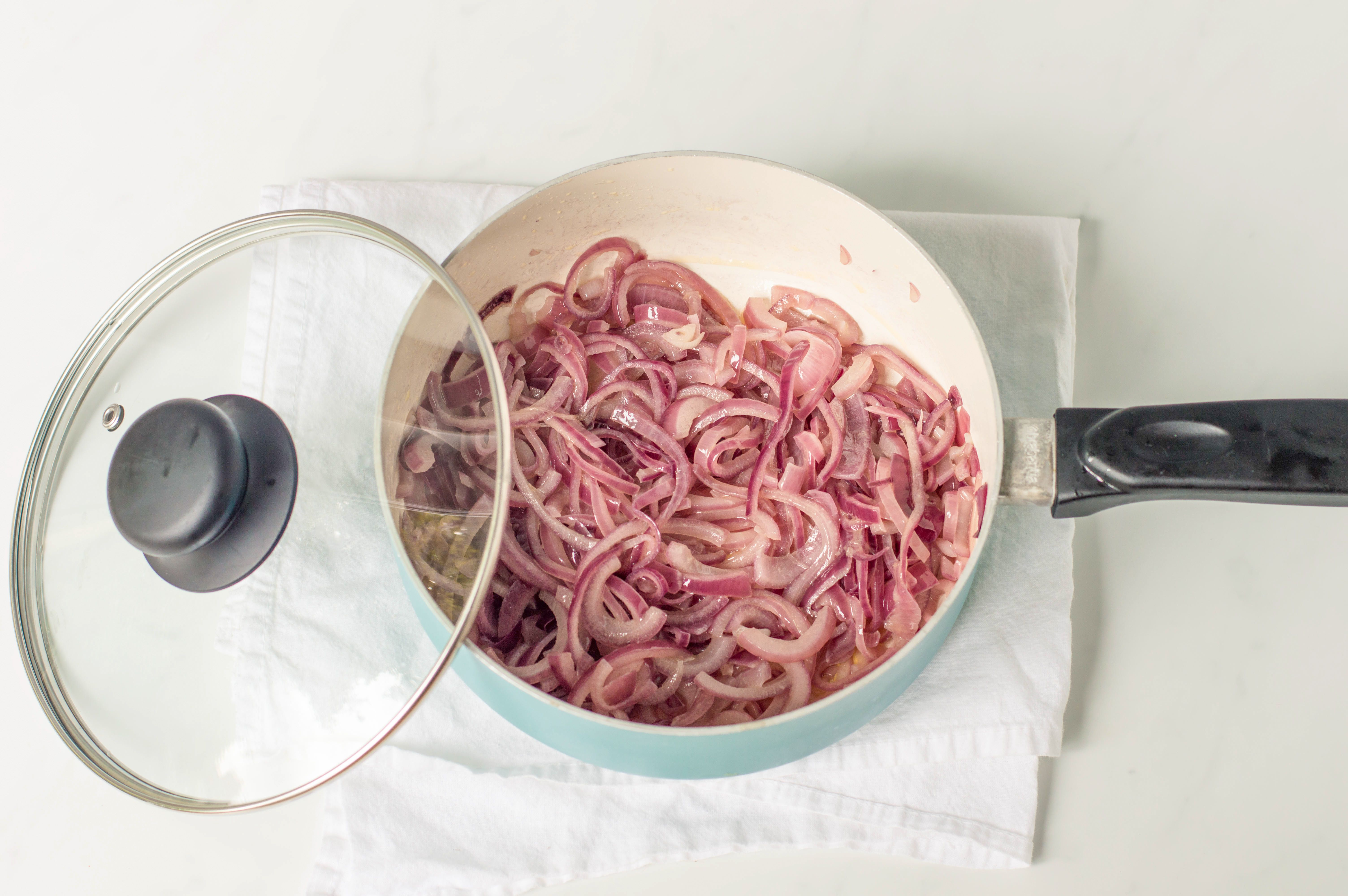 Gently cooked onions in a pan