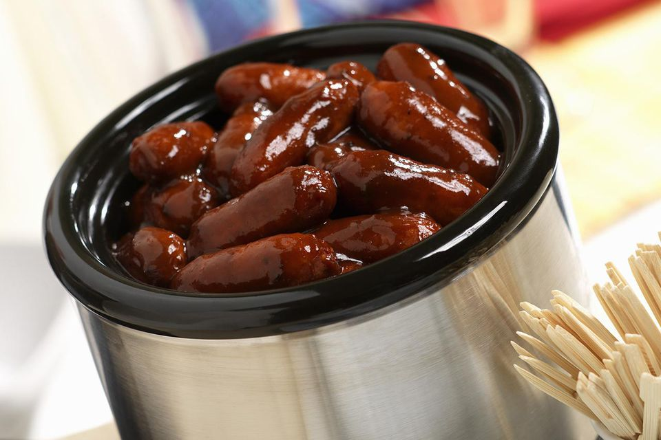 Cocktail franks in barbecue sauce in slow cooker