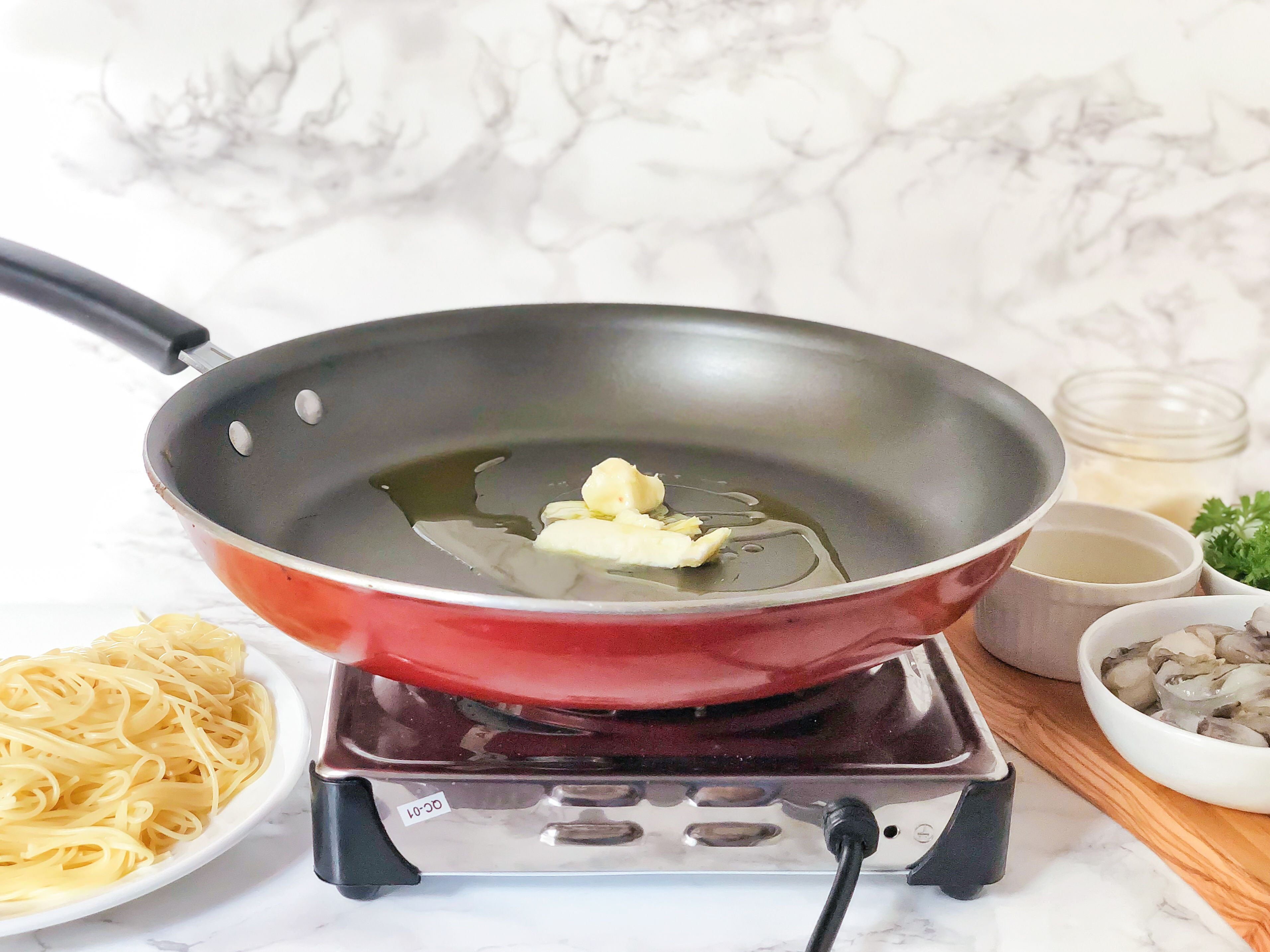 Saute butter and oil in saucepan