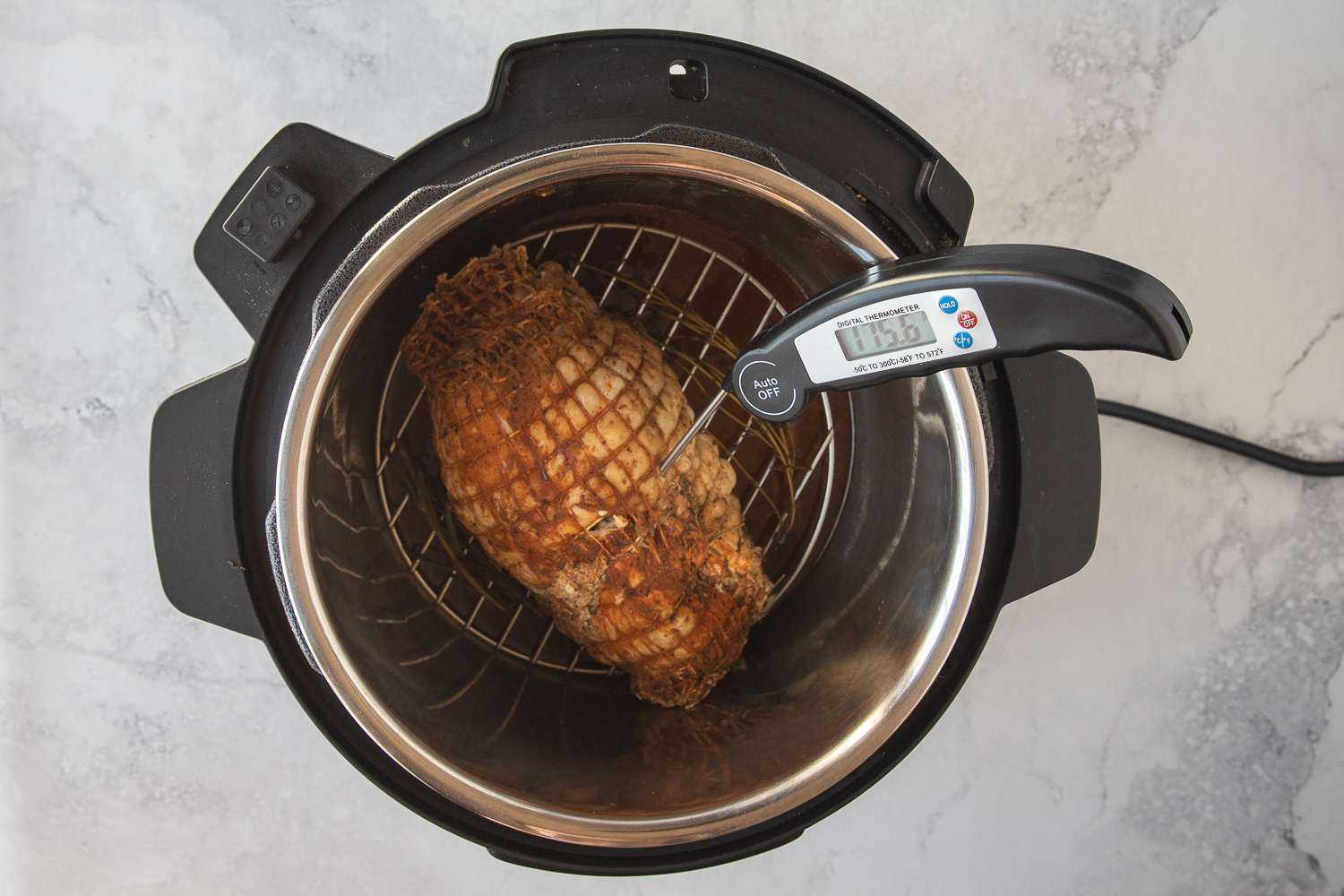 turkey in an instant pot, meat thermometer inserted