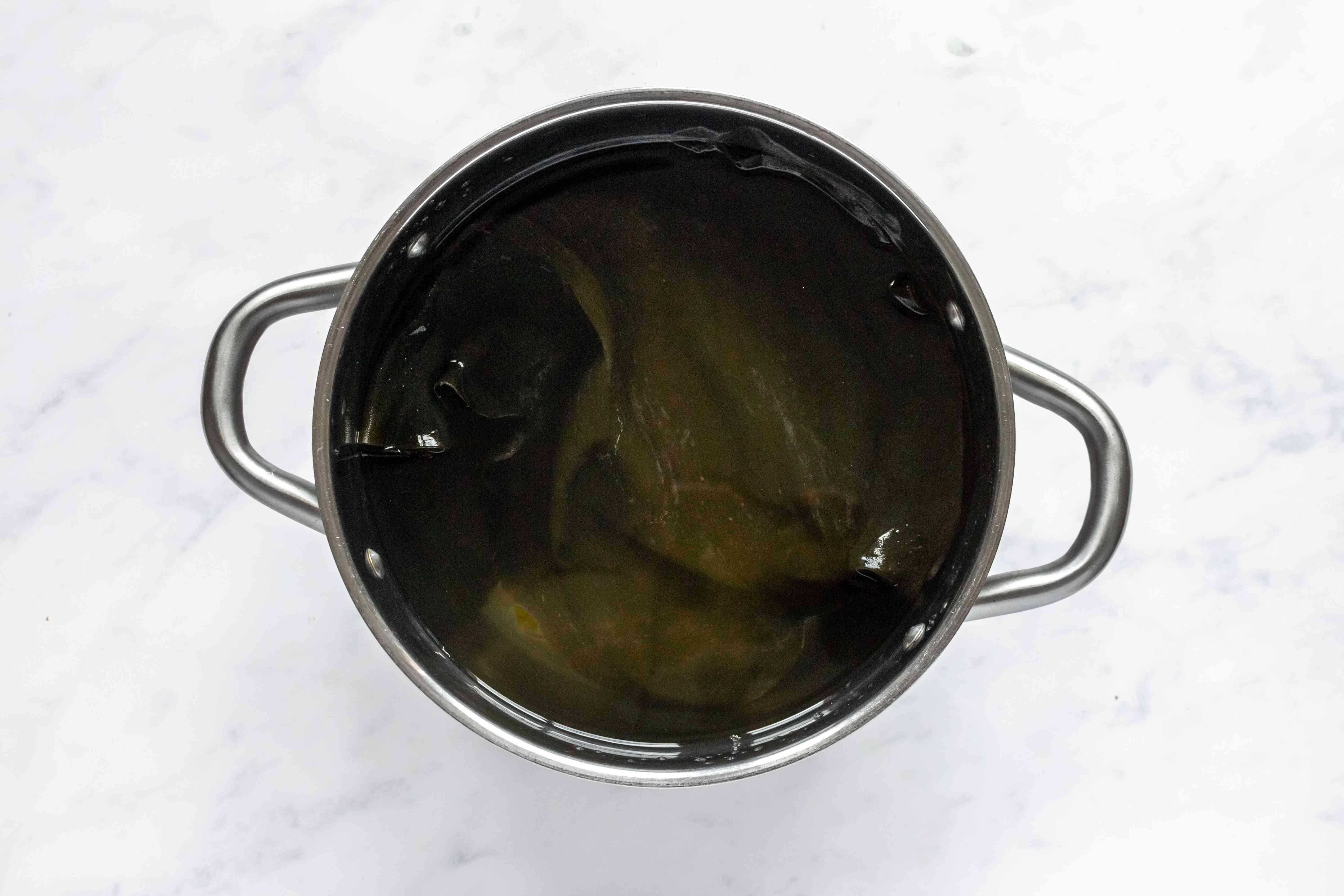 dried dashi konbu and water in a pot
