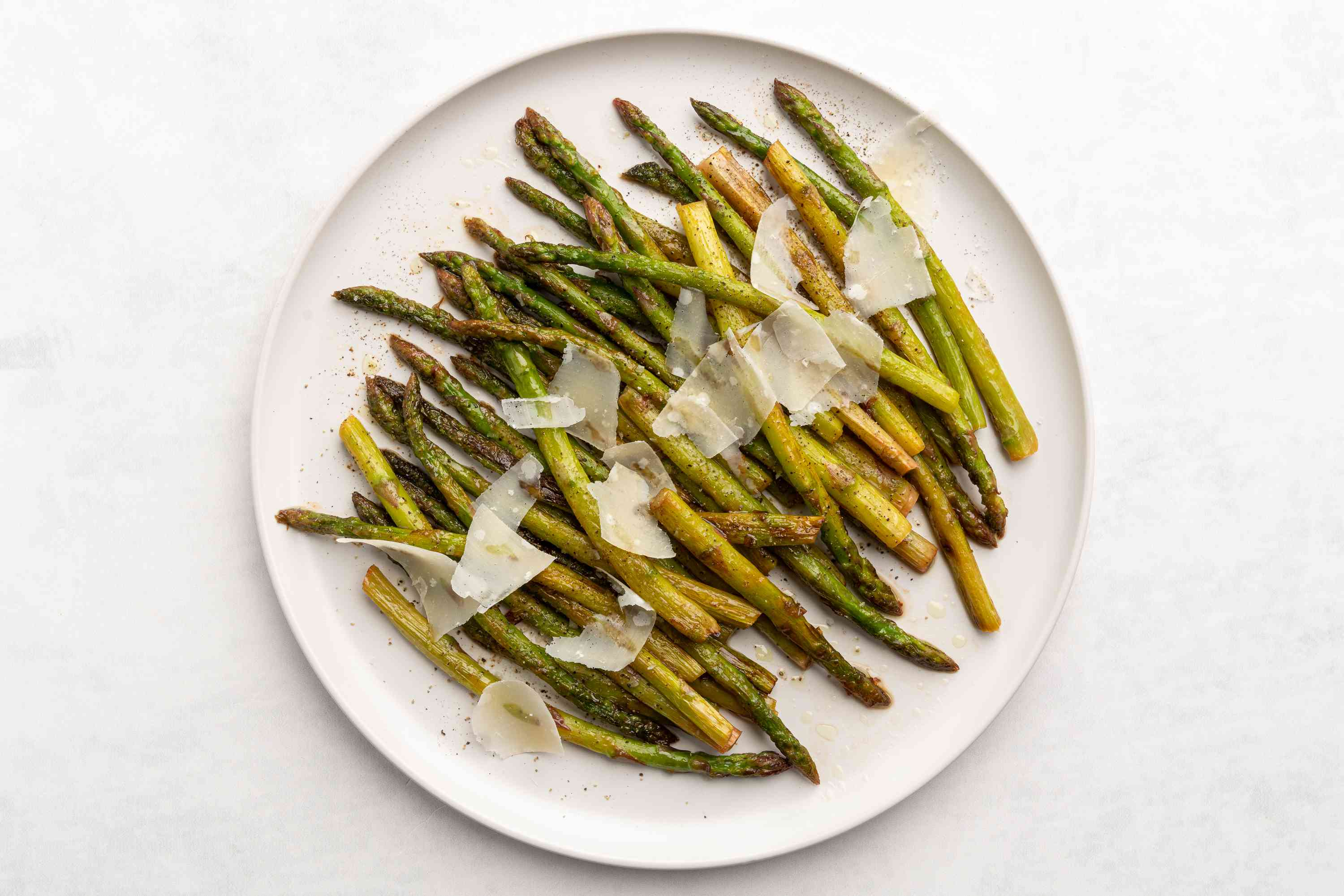 Pan-Roasted Asparagus With Lemon and Garlic, served with shaved Parmesan