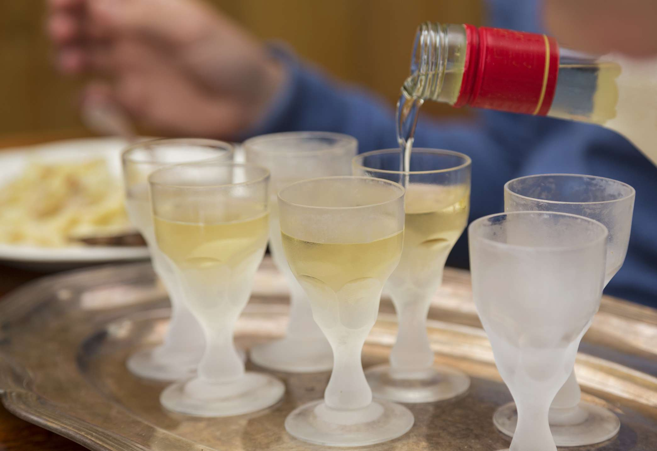 Aquavit poured into frosting glasses