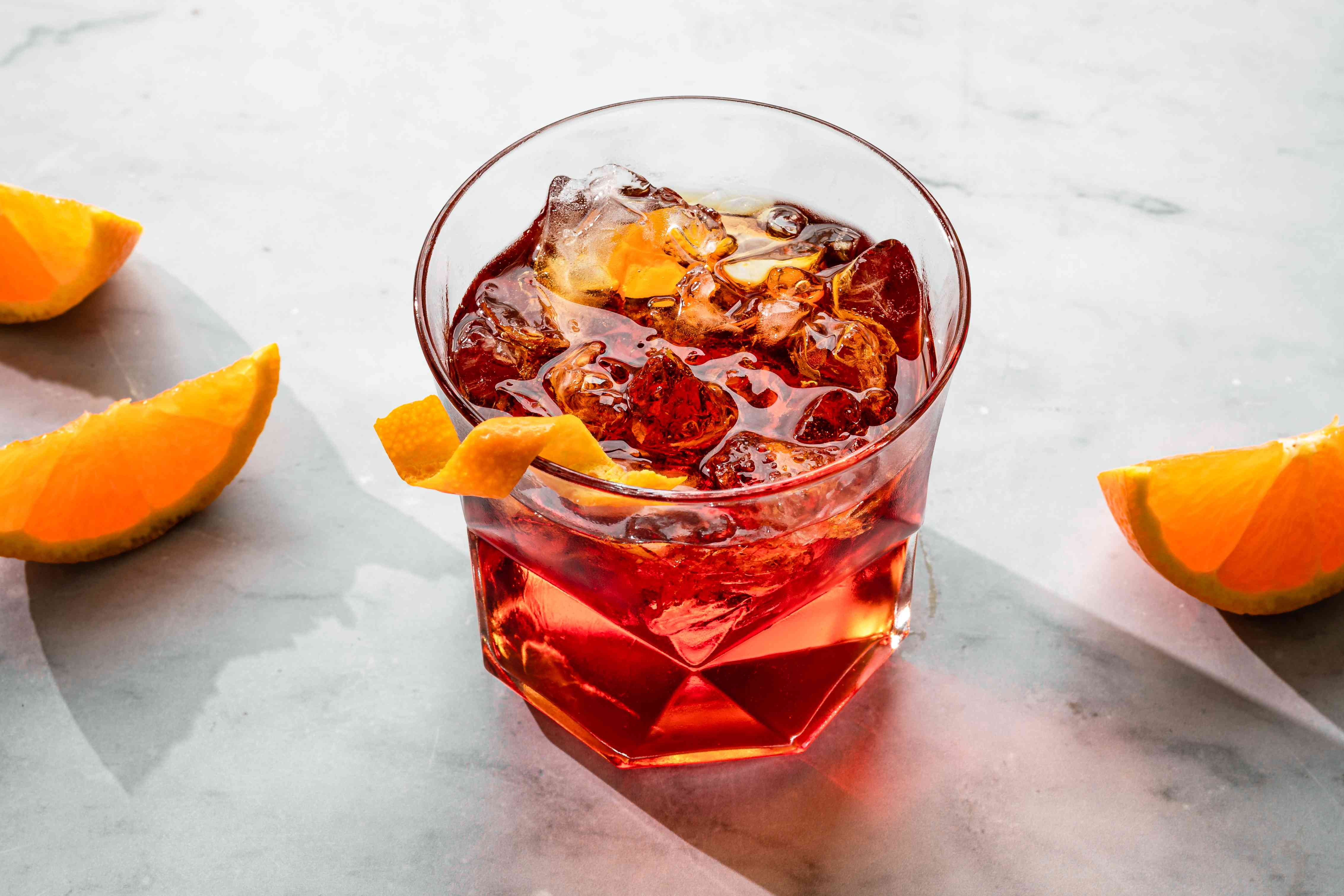 Negroni in a glass with a twist of orange