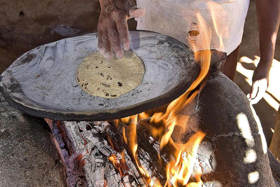 Native Mayo woman making tortillas by hand in small village of Capomos outside El Fuerte in Sinaloa state of Mexico