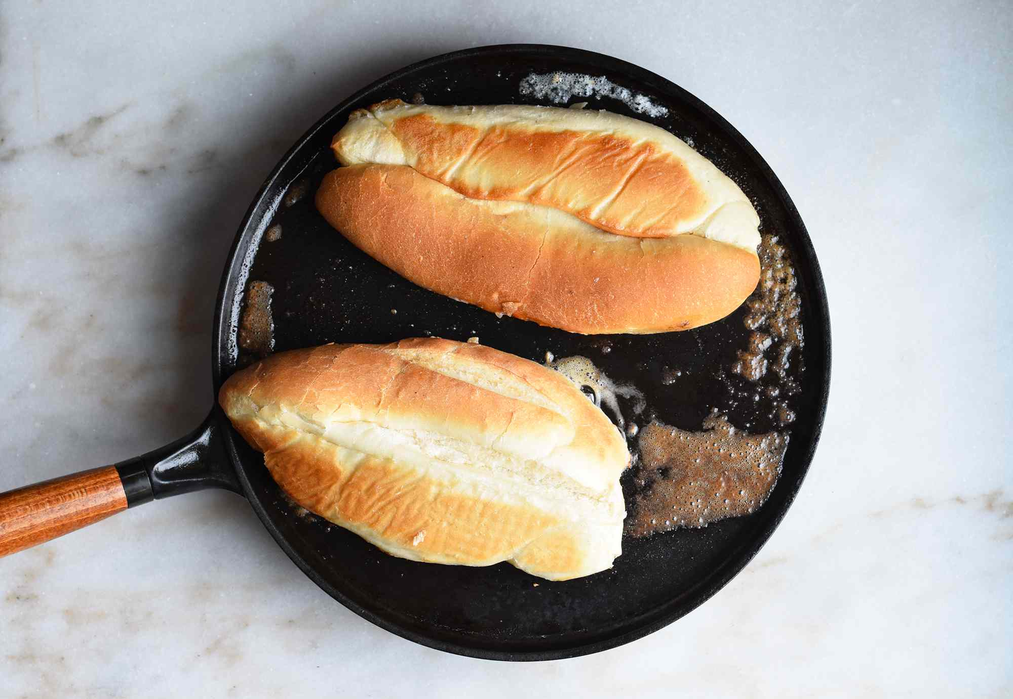 hoagie rolls grilled in a buttered pan