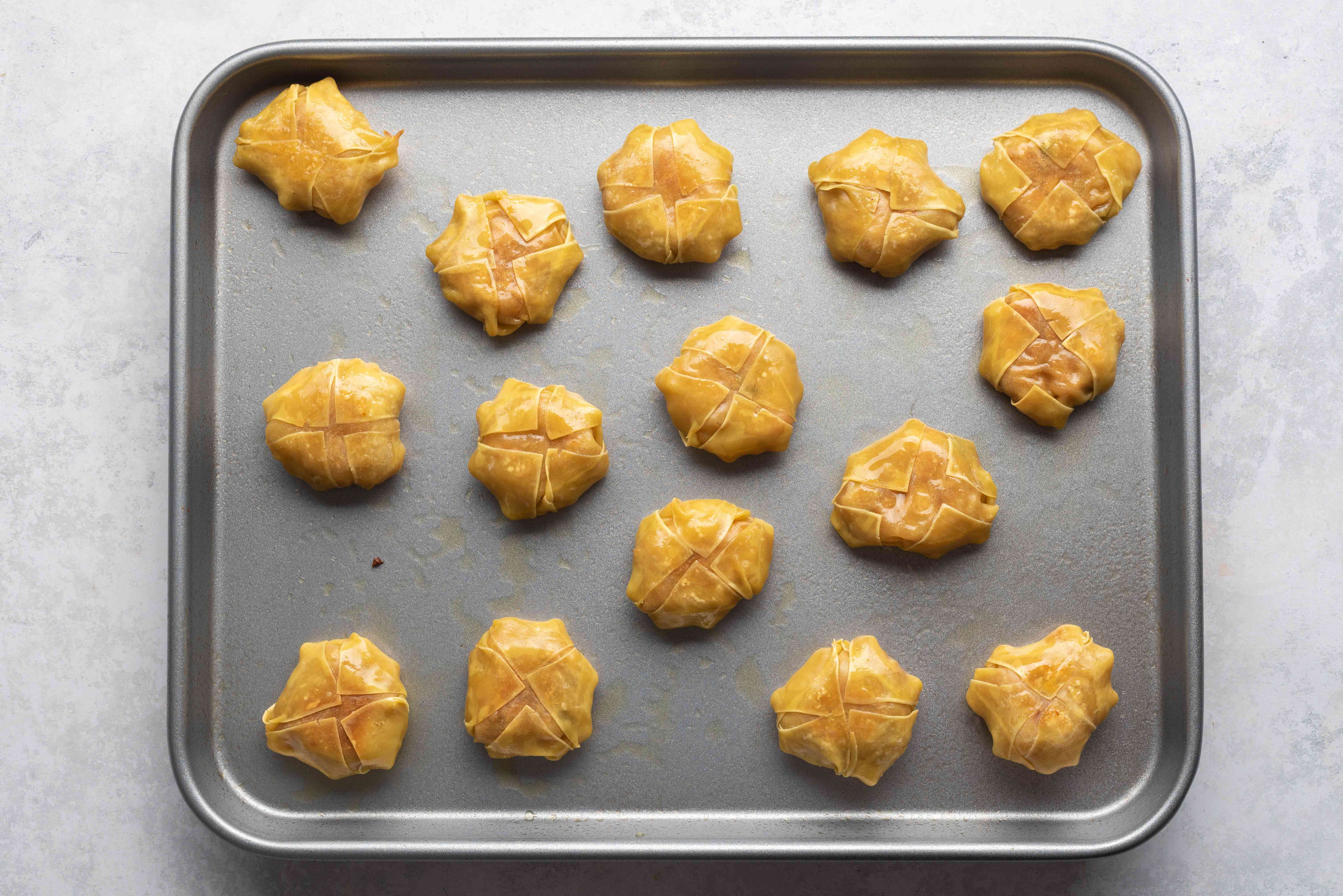 Healthy Baked Chicken Wontons on a baking sheet