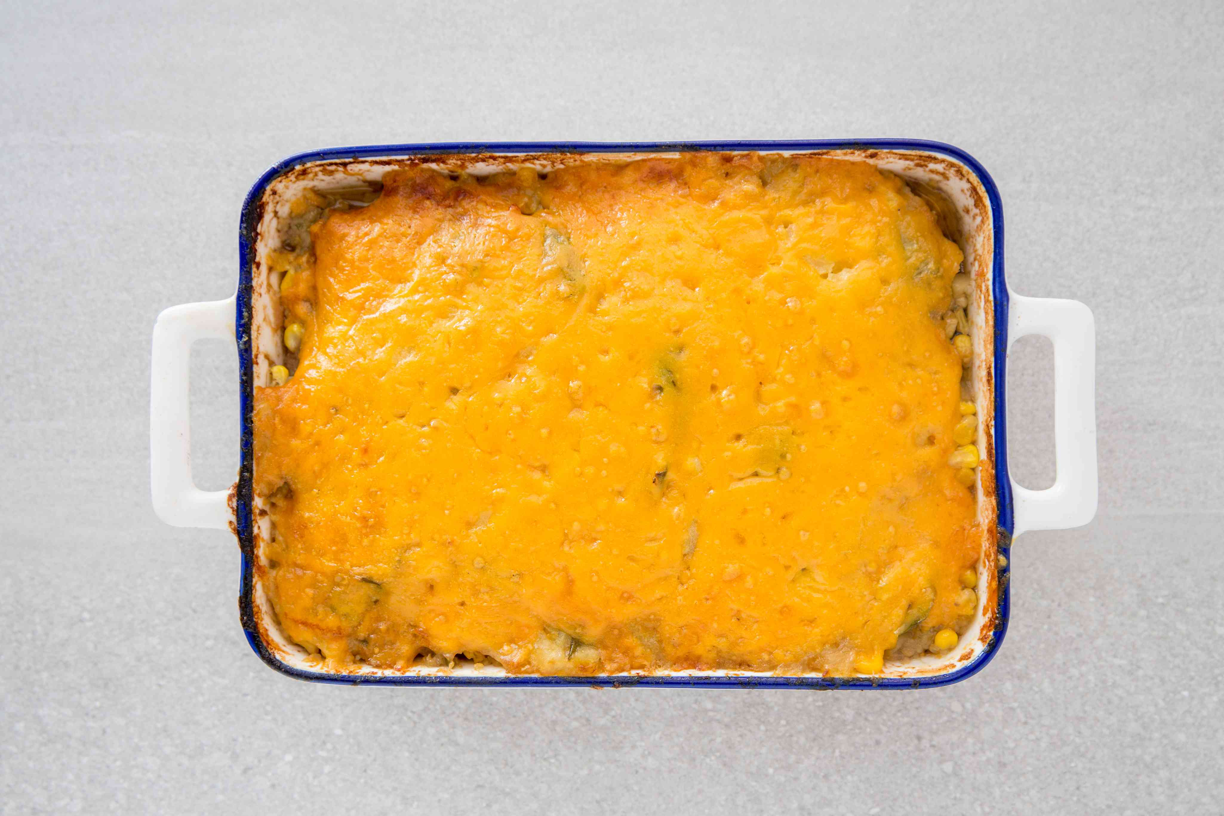 Ground Beef Casserole With Potatoes and Cheese in a baking dish