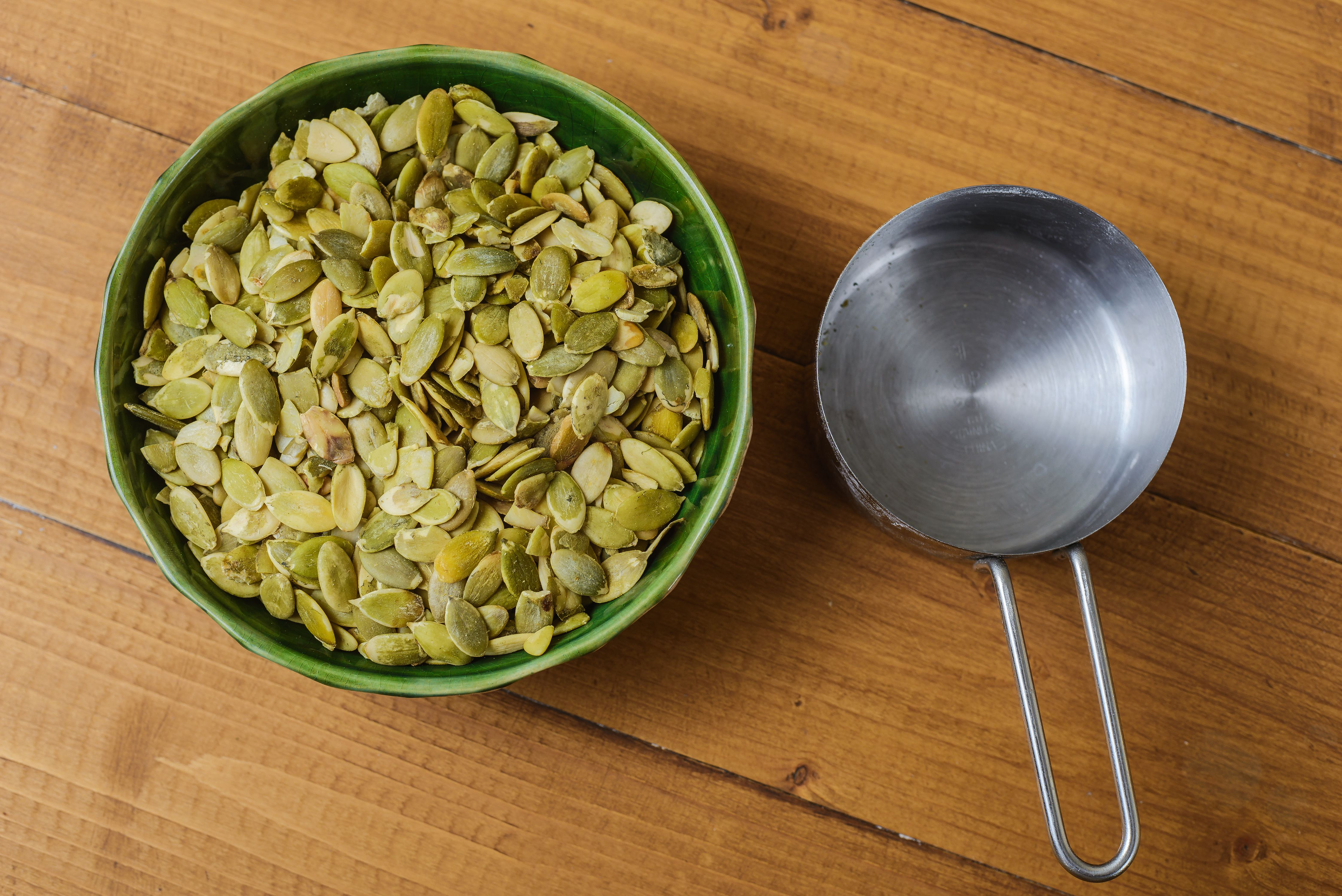 Measure out pumpkin seeds