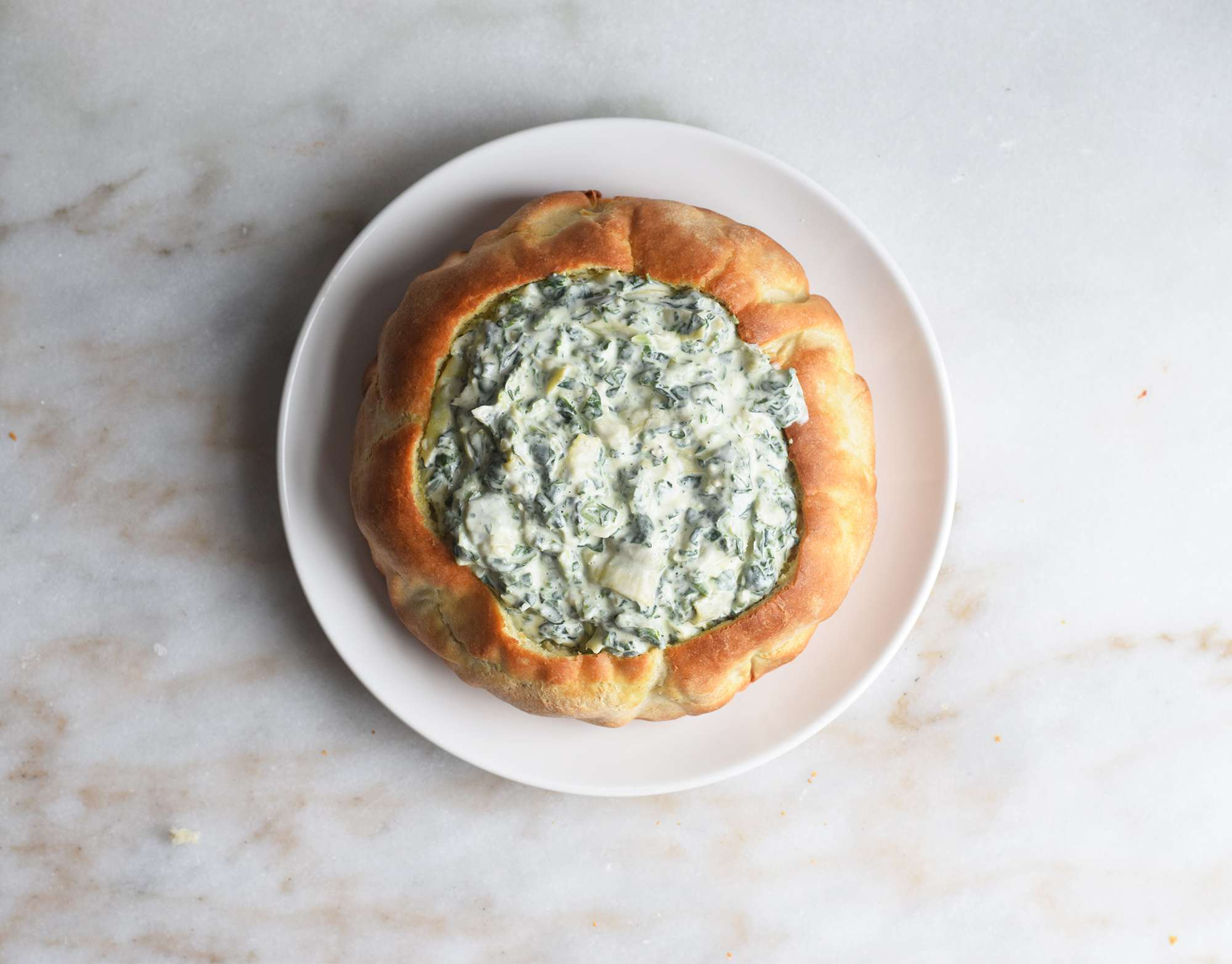 spinach dip served in a bread bowl