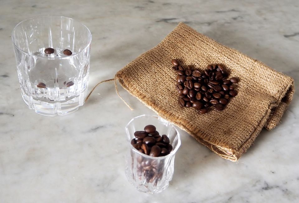 Coffee beans in shot glass, on burlap and in coffee sambuca.
