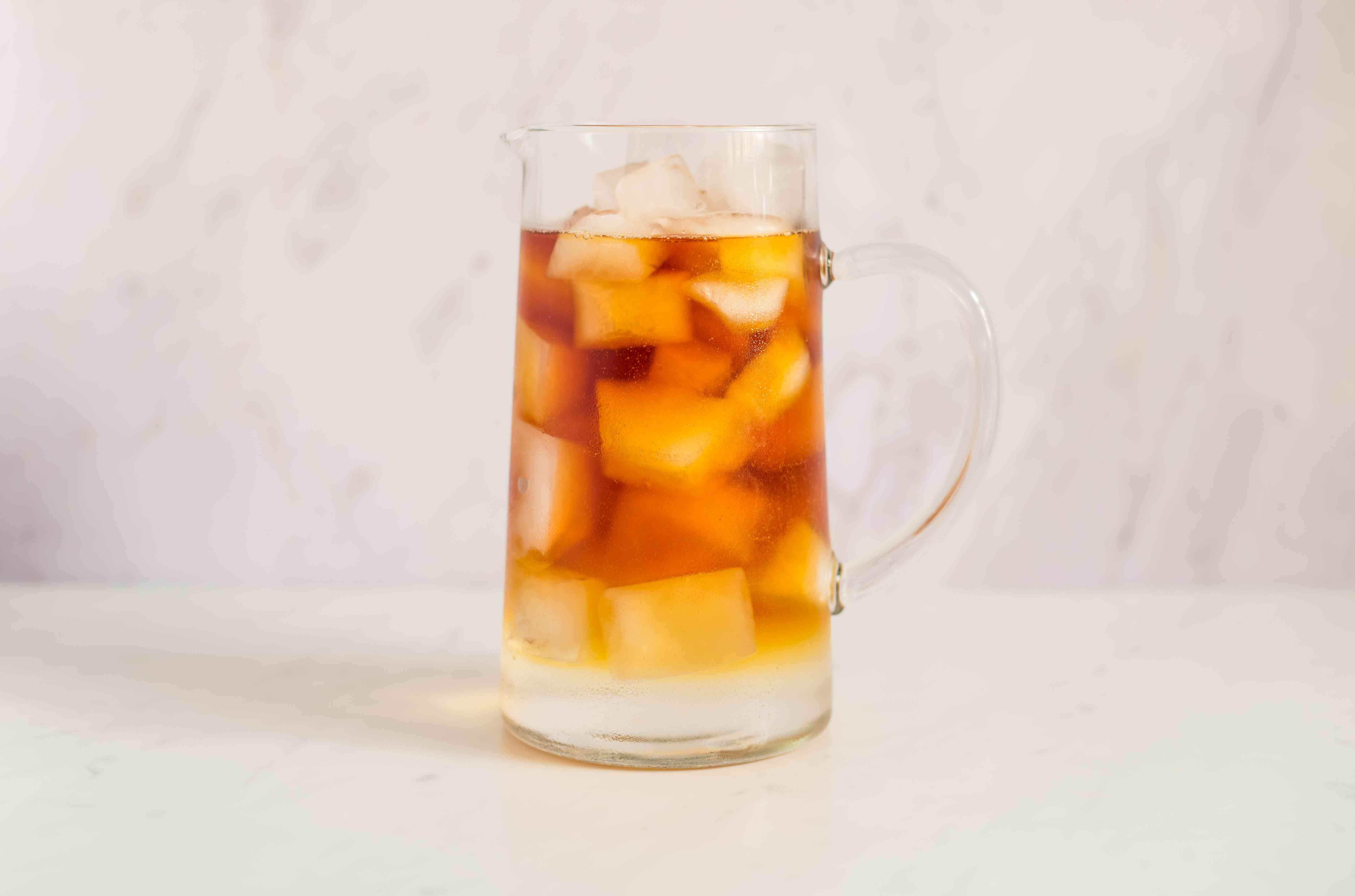 Pimm's, lemonade, and ice in a pitcher