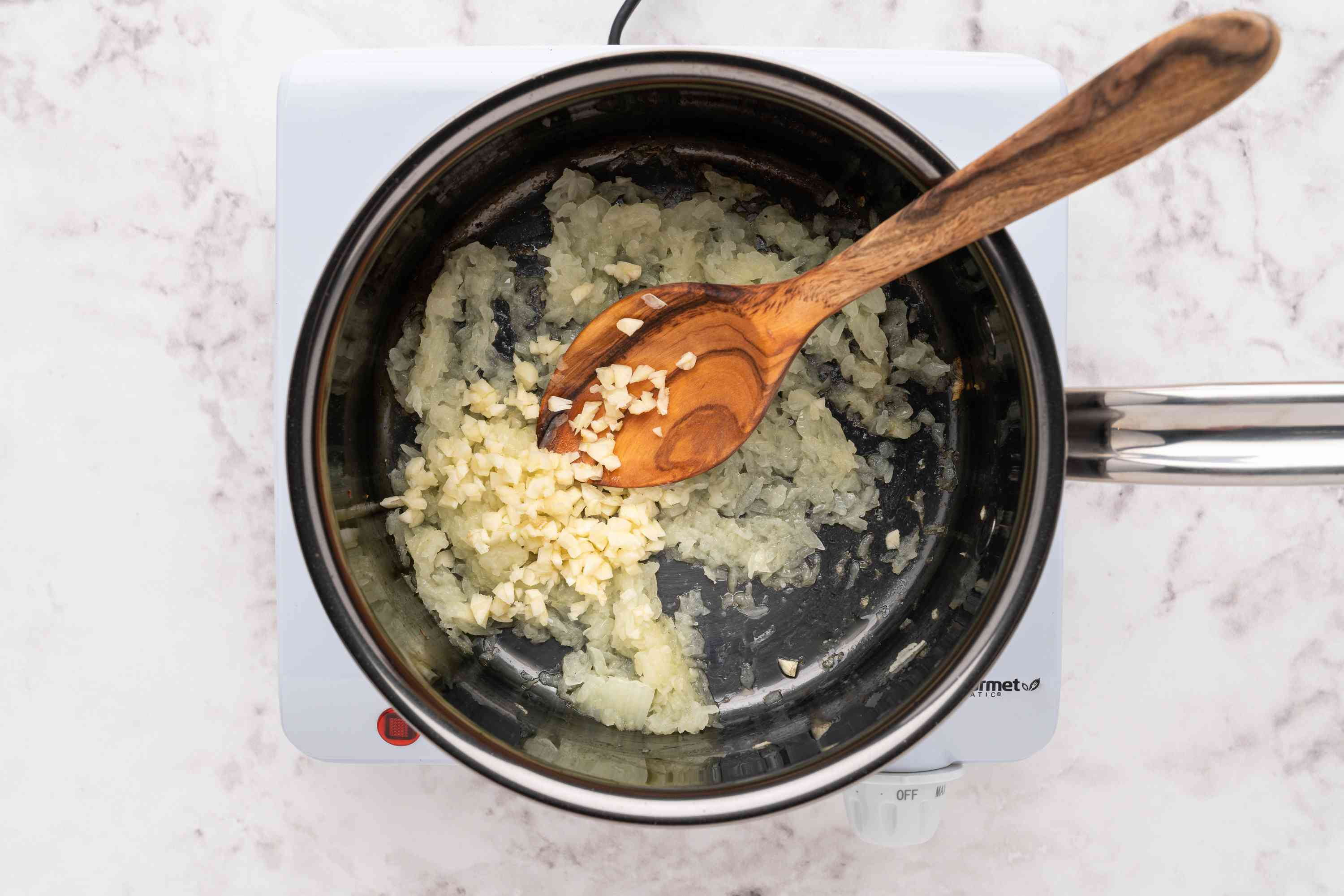 garlic and onions cooking in a saucepan