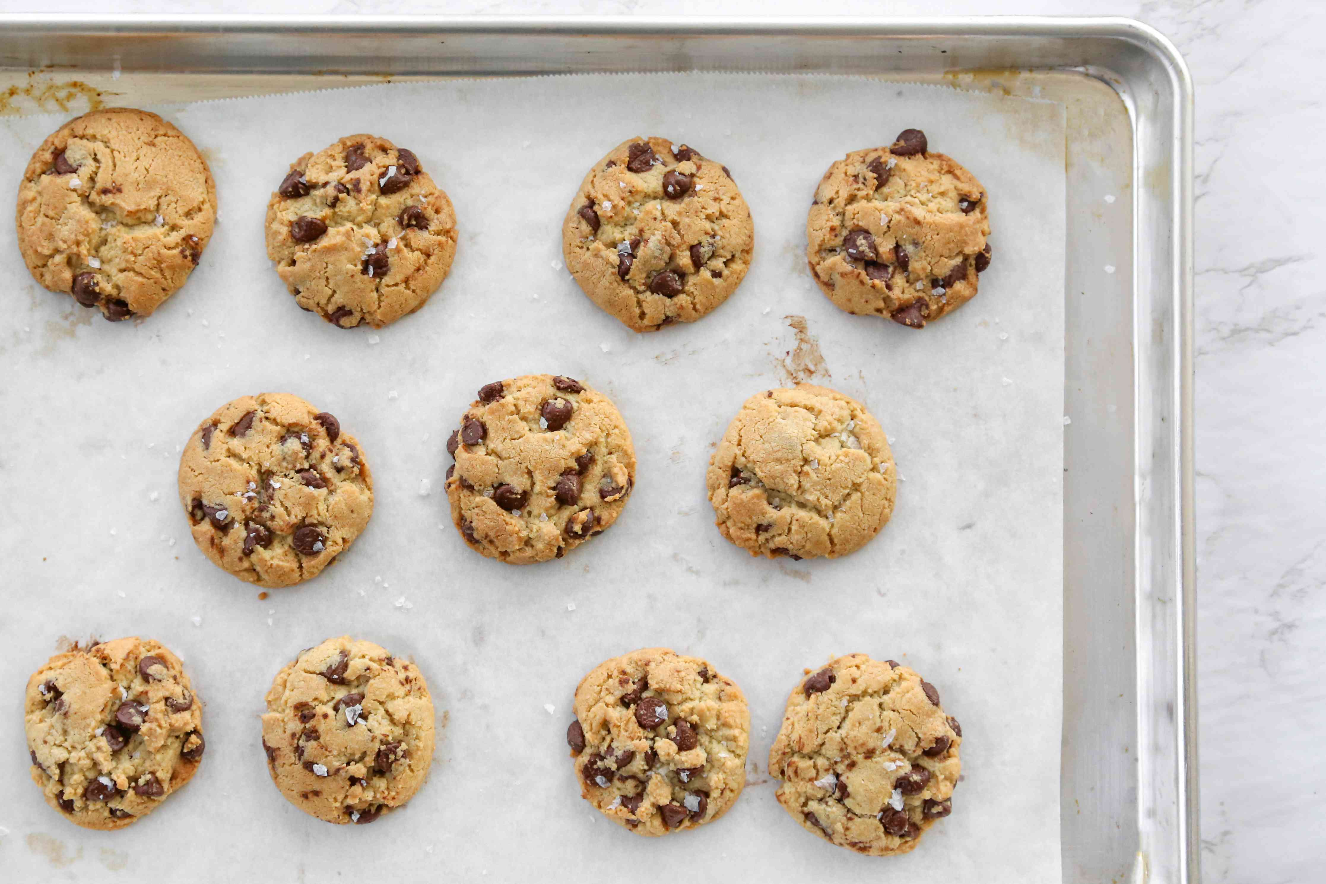 Salted Chocolate Chip Tahini Cookies on a baking sheet